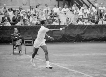 Arthur Ashe hits a running forehand during his 5 set victory over Tom Okker in the 1968 US Open Men's Singles Championship. September 9, 1968. Photo by John G. Zimmerman.
