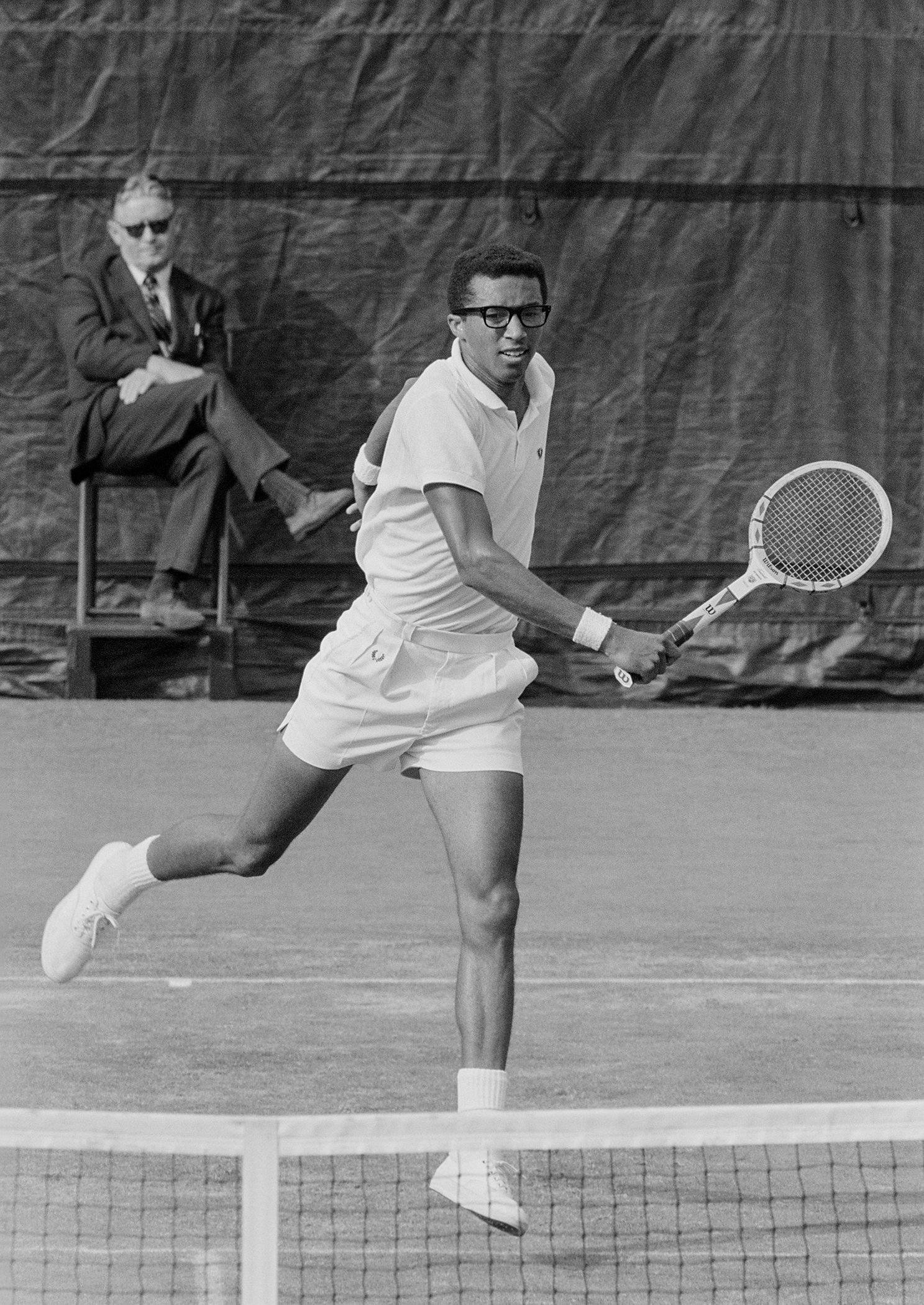American tennis player Arthur Ashe (1943 - 1993) playing in the US Open final against Tom Okker of the Netherlands. West Side Tennis Club, Forest Hills, N.Y., Sept. 9, 1968. Photographer John G. Zimmerman