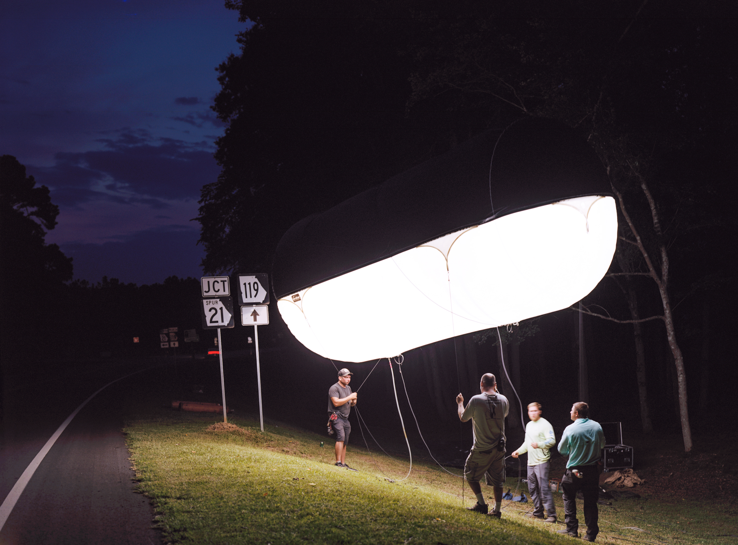 The crew adjusts a lighting balloon on the set of Emperor in Springfield, Ga.