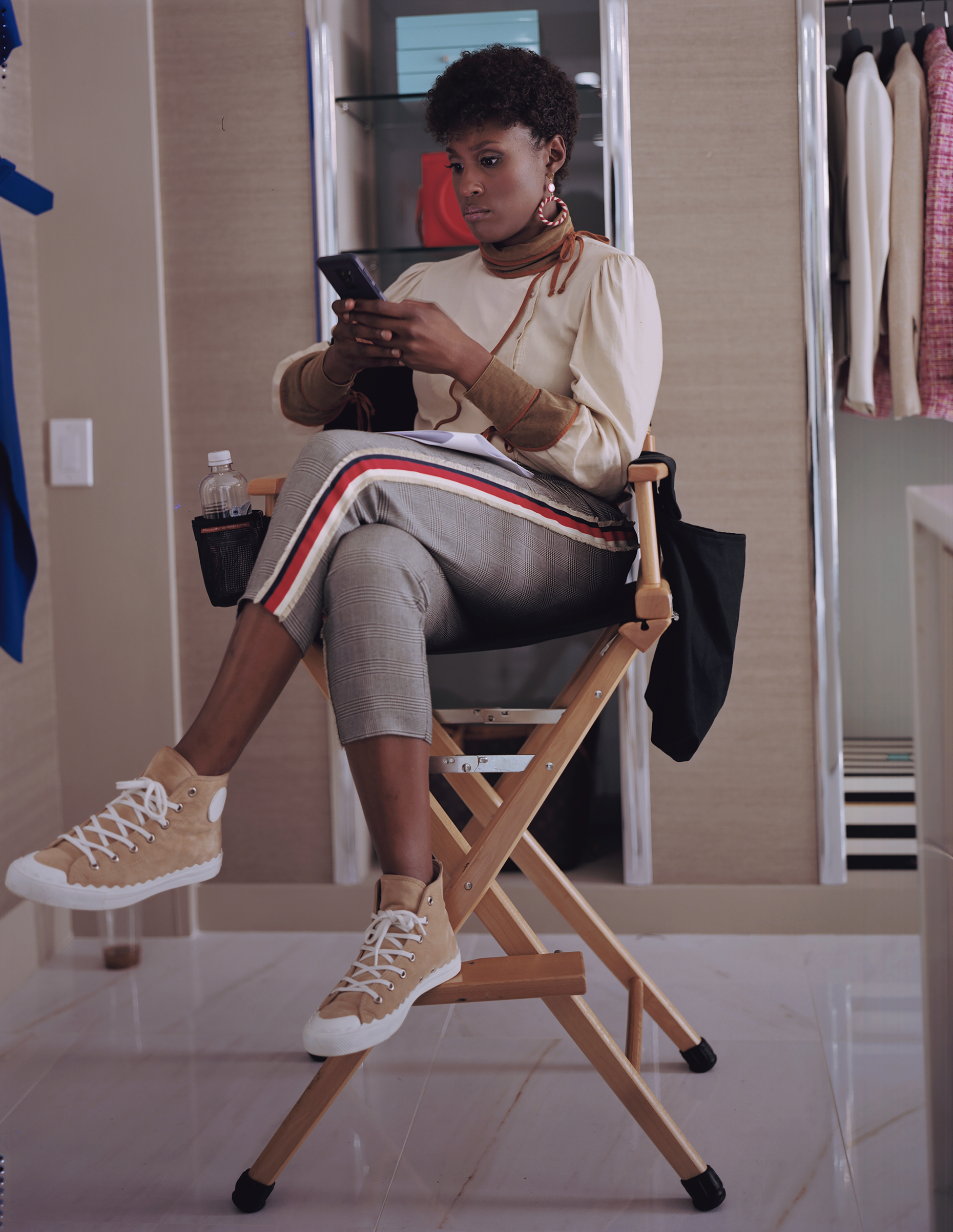 Issa Rae looks over her script on the set of Universal Pictures' Little. Marsai Martin is executive-producing with Will Packer, who has grossed some $500 million at the box office with other Georgia-based films like Ride Along, No Good Deed and Stomp the Yard.
