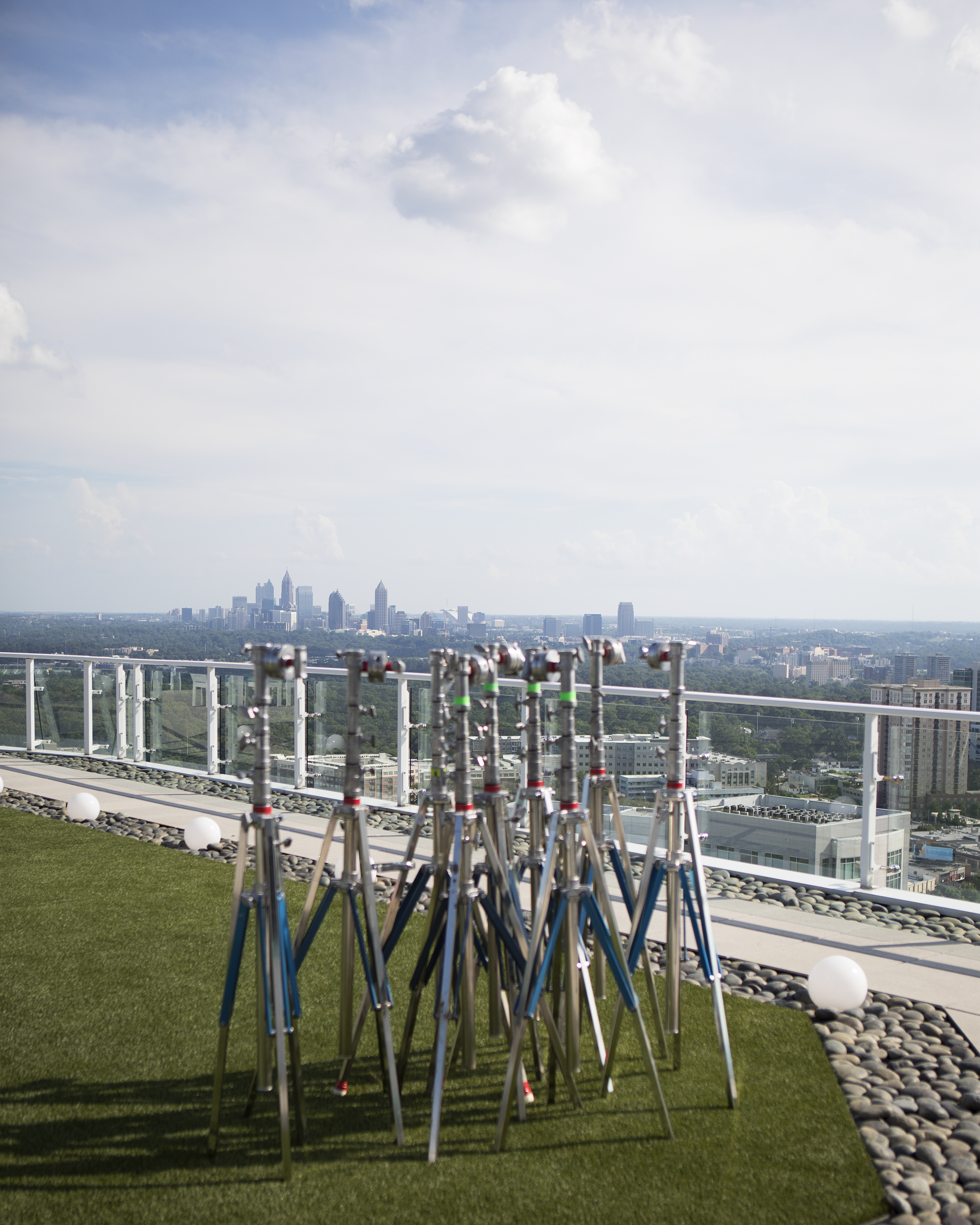 A cluster of lighting stands on the set of comedy Little by Universal Pictures' overlook the Atlanta skyline from the Terminus building.
