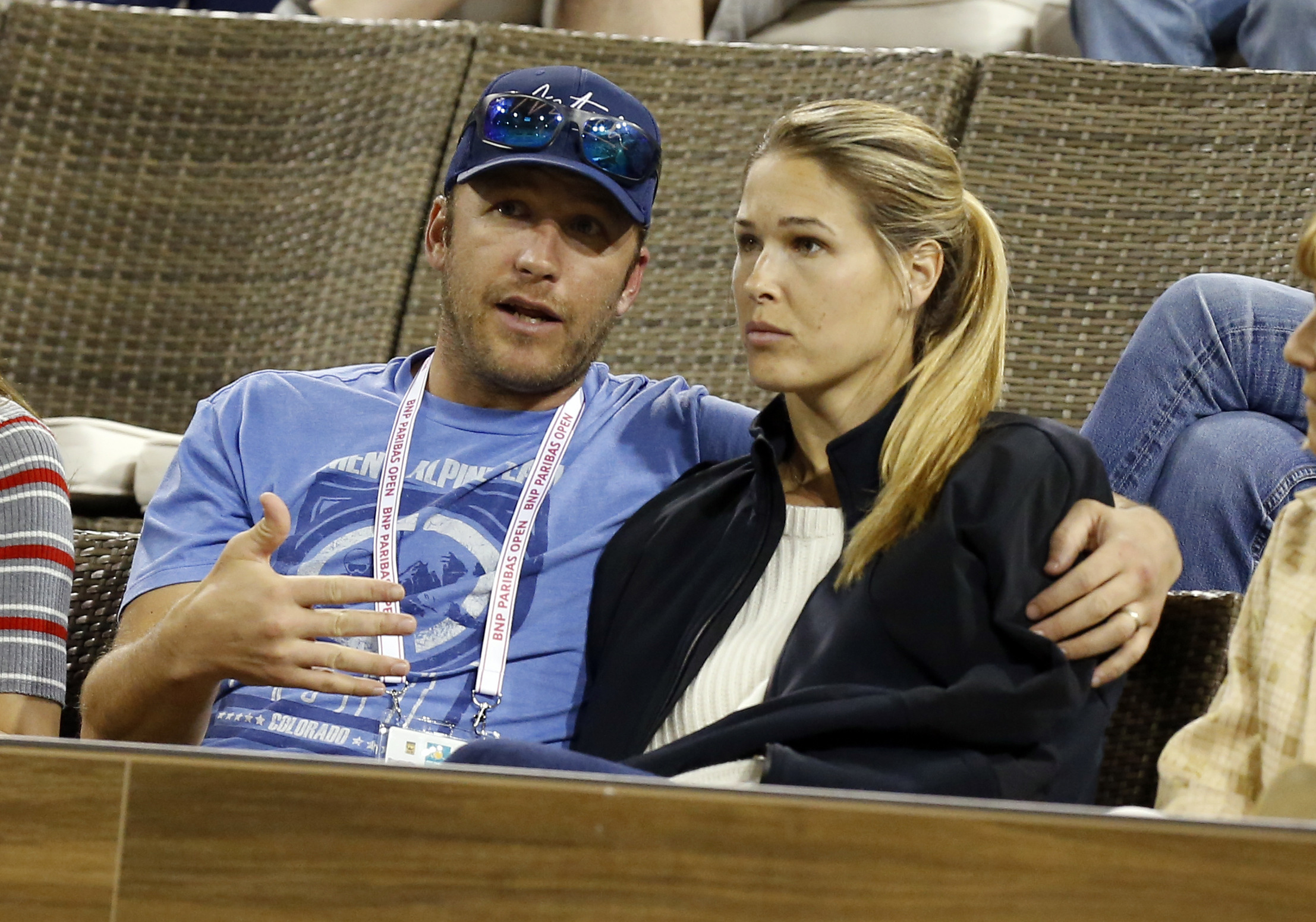 Alpine skier  Bode Miller and Morgan Beck views a second round match between Roger Federer and Federico Debonis at the BNP Paribas Open on March 10, 2018, at the Indian Wells Tennis Gardens in Indian Wells, CA.