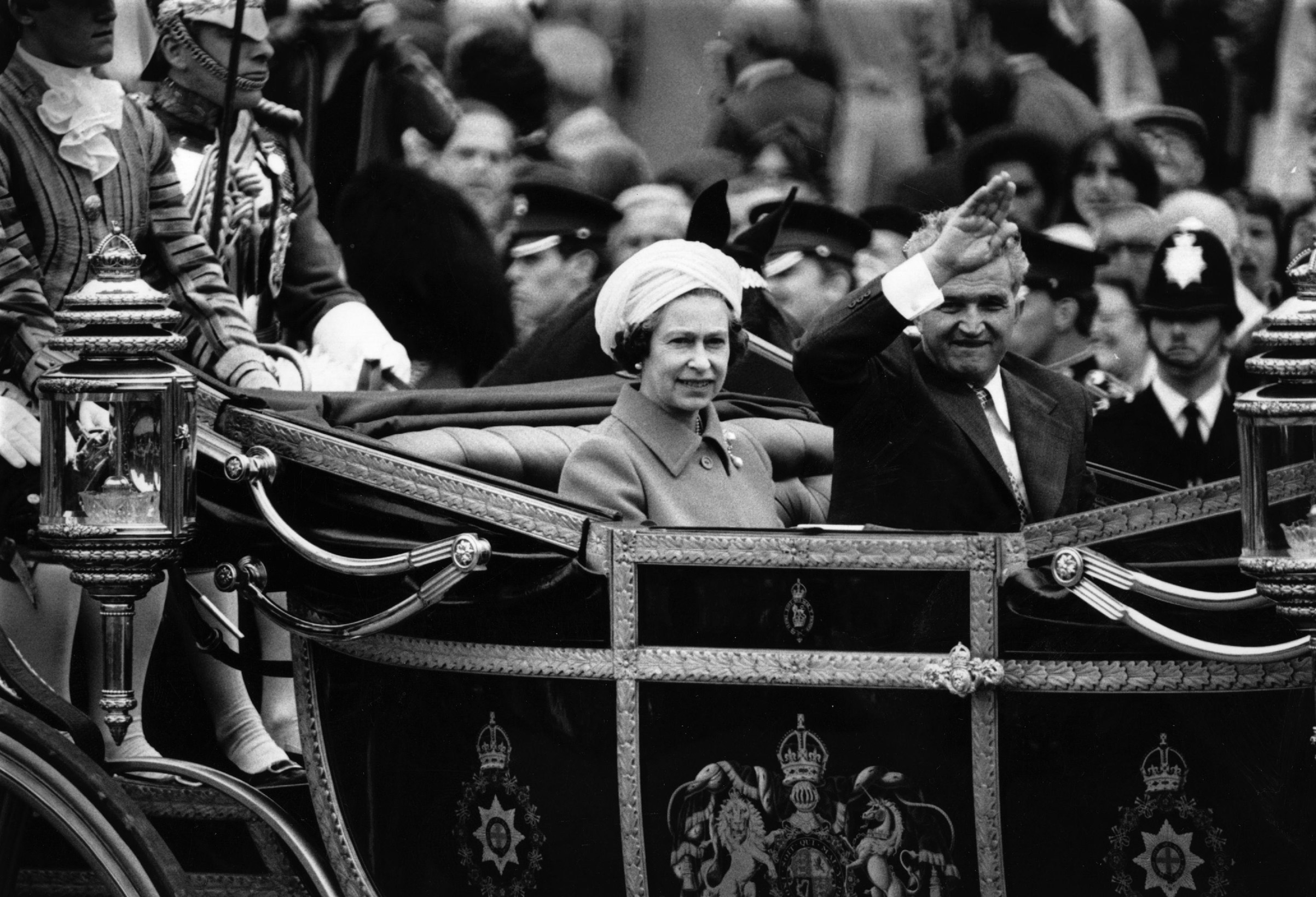 Romanian dictator Nicolae Ceausescu rides in the state carriage with Queen Elizabeth II on his official visit to Britain on June 13, 1978.