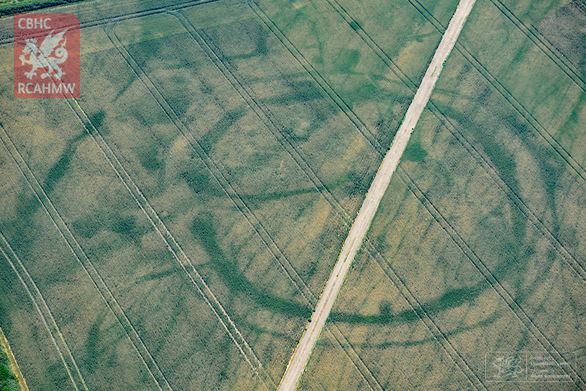 A large prehistoric circular structure in Wales revealed by hot weather. Surveyors think the hot weather has revealed traces of a Roman villa within.