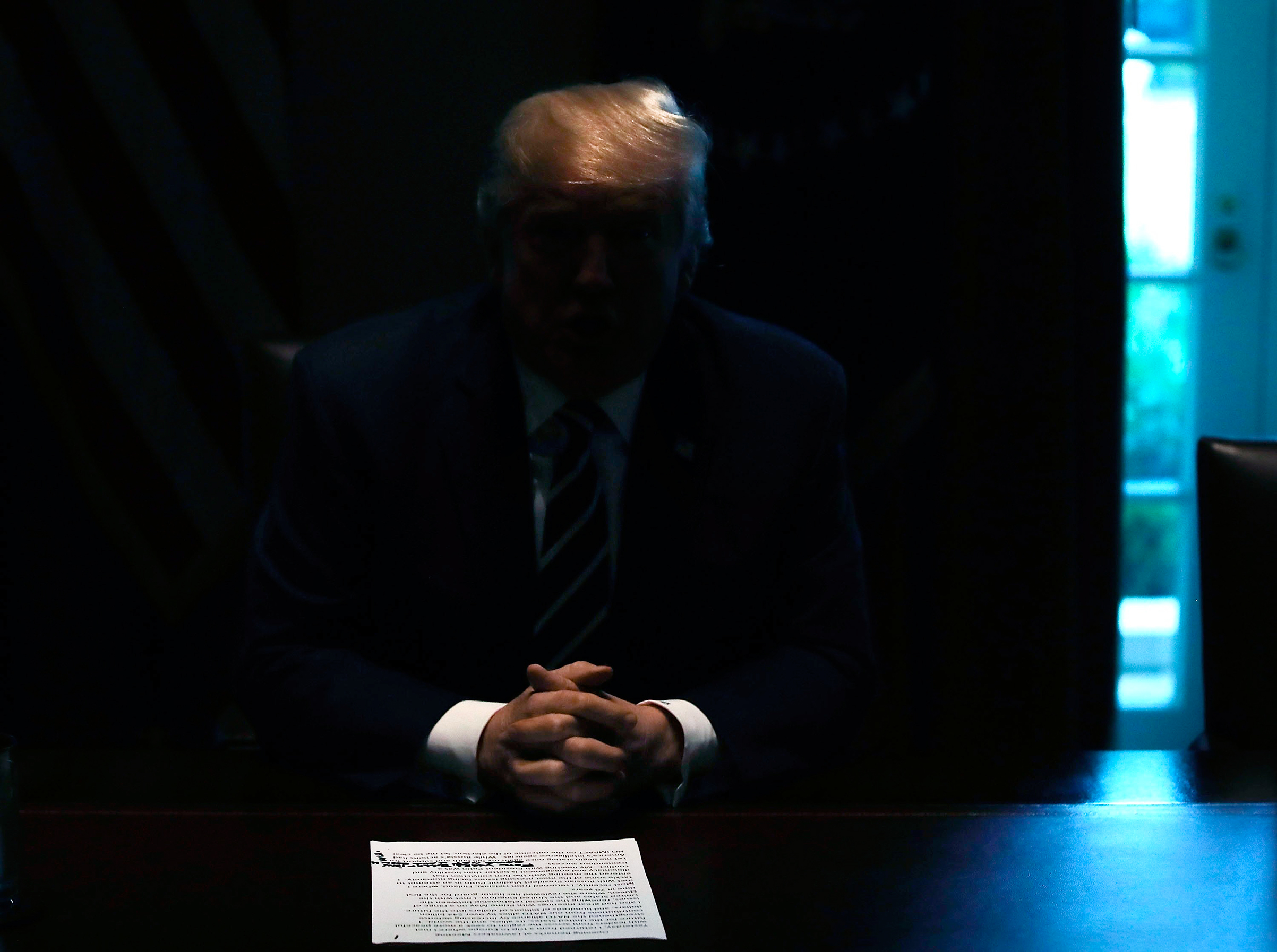 The lights in the White House CabinetRoom went dark on July 17 as Trump addressed criticism of his failure toconfront Vladimir Putin in Helsinki