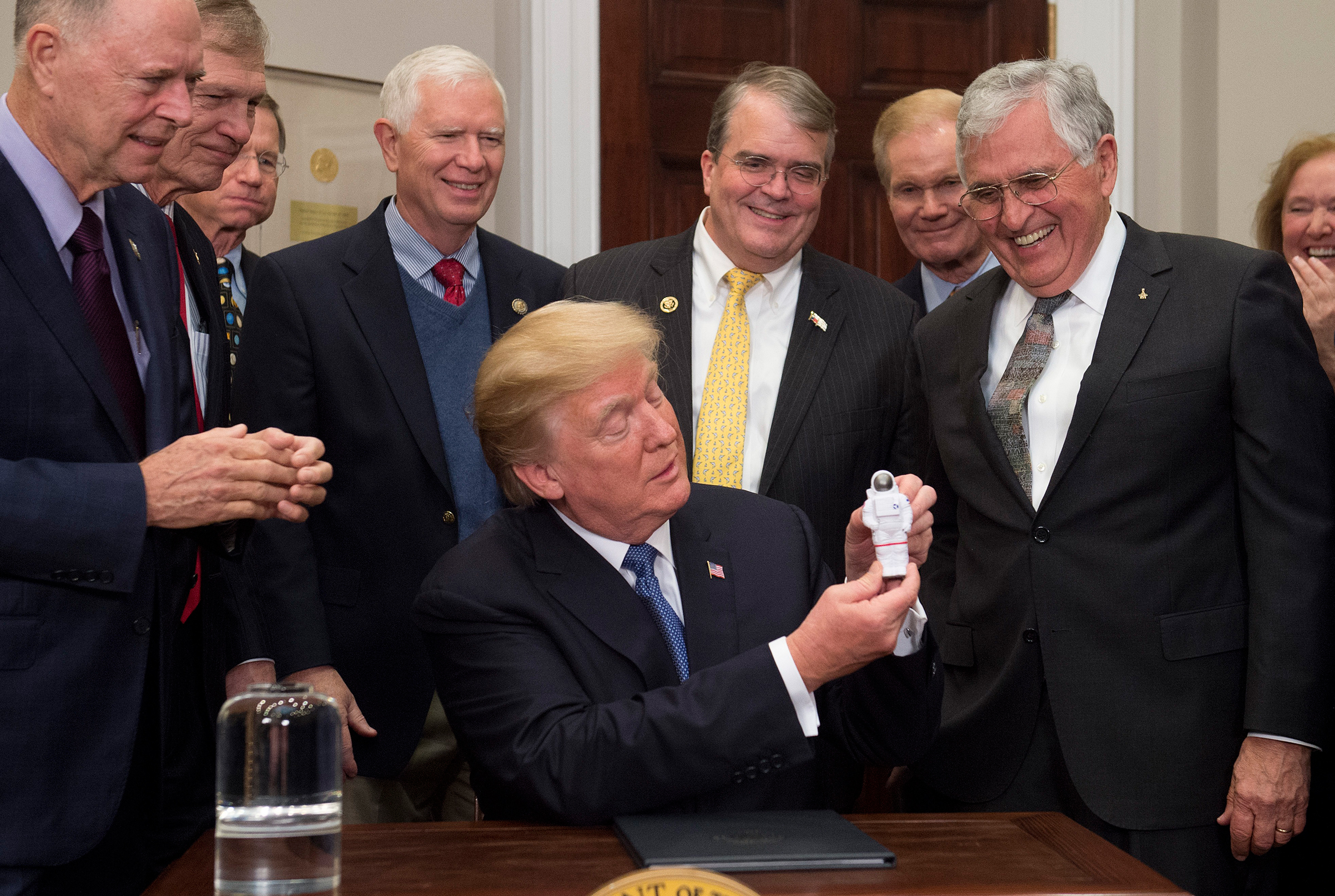 President Trump during the signing of his first space directive, with moonwalker and former Senator Harrison Schmitt, at right