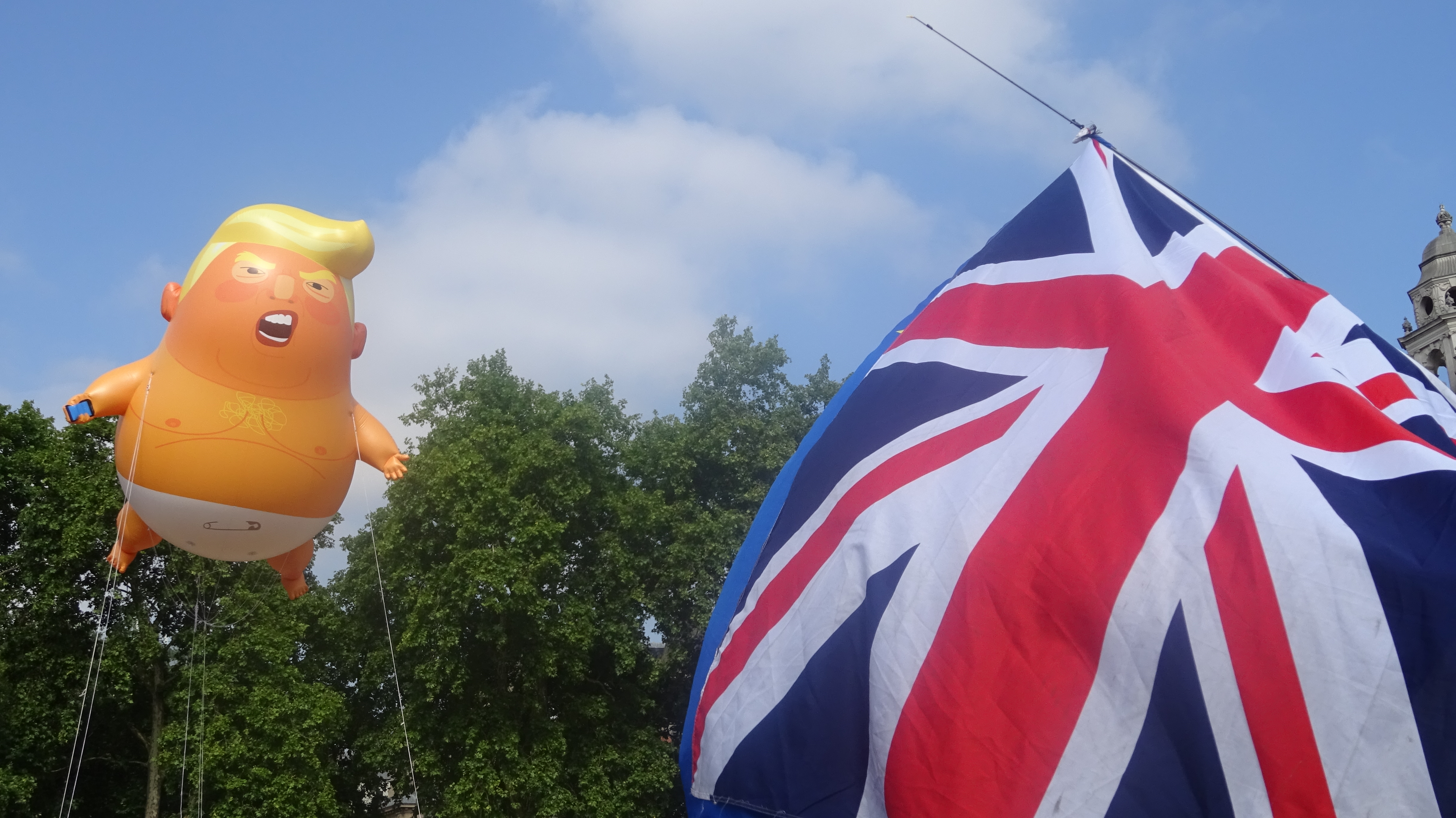 A balloon depicting Trump as an angry orange baby flies in Parliament Square, central London