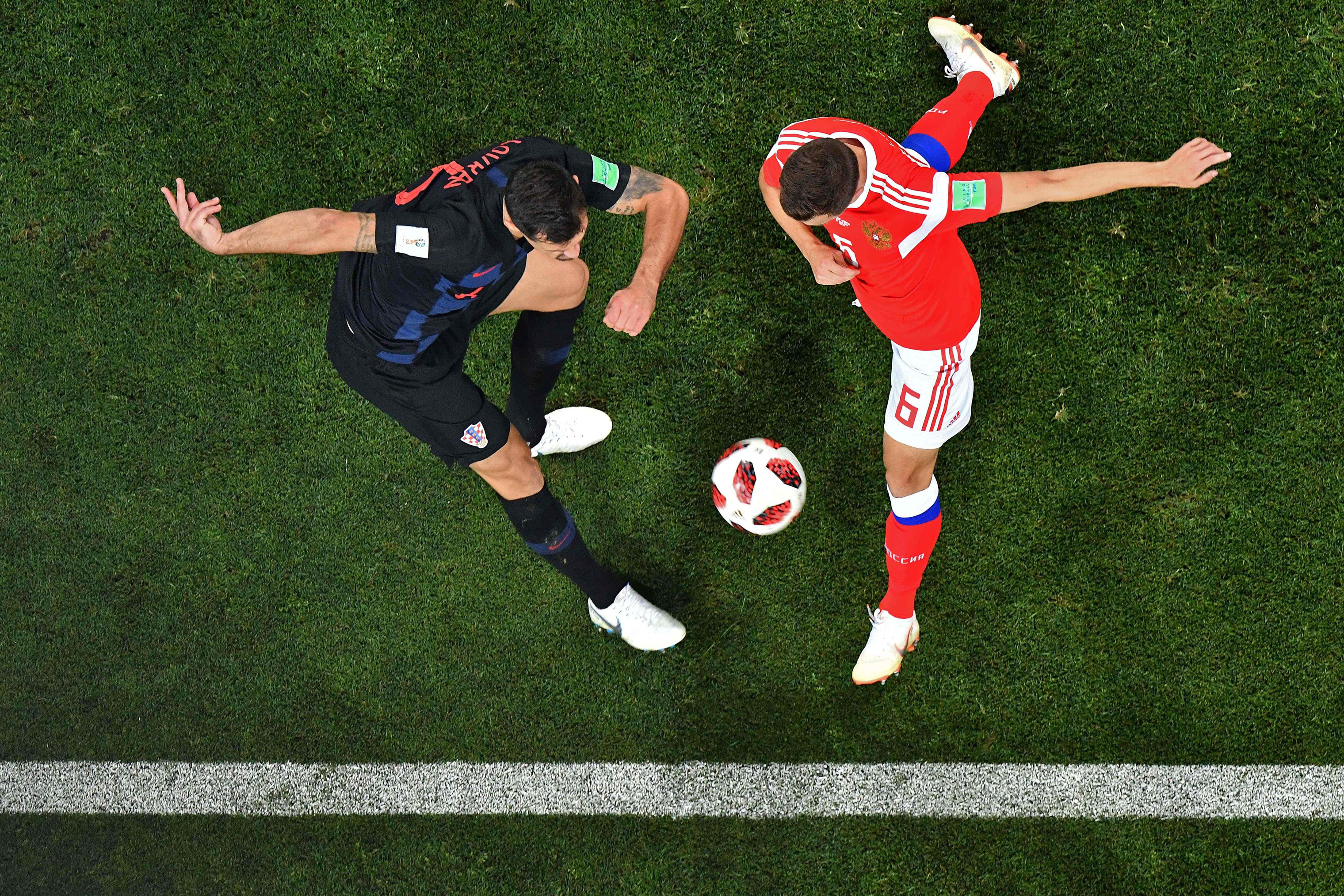 Croatia's defender Dejan Lovren vies with Russia's midfielder Denis Cheryshev during the quarter-final football match between Russia and Croatia on July 7, 2018.
