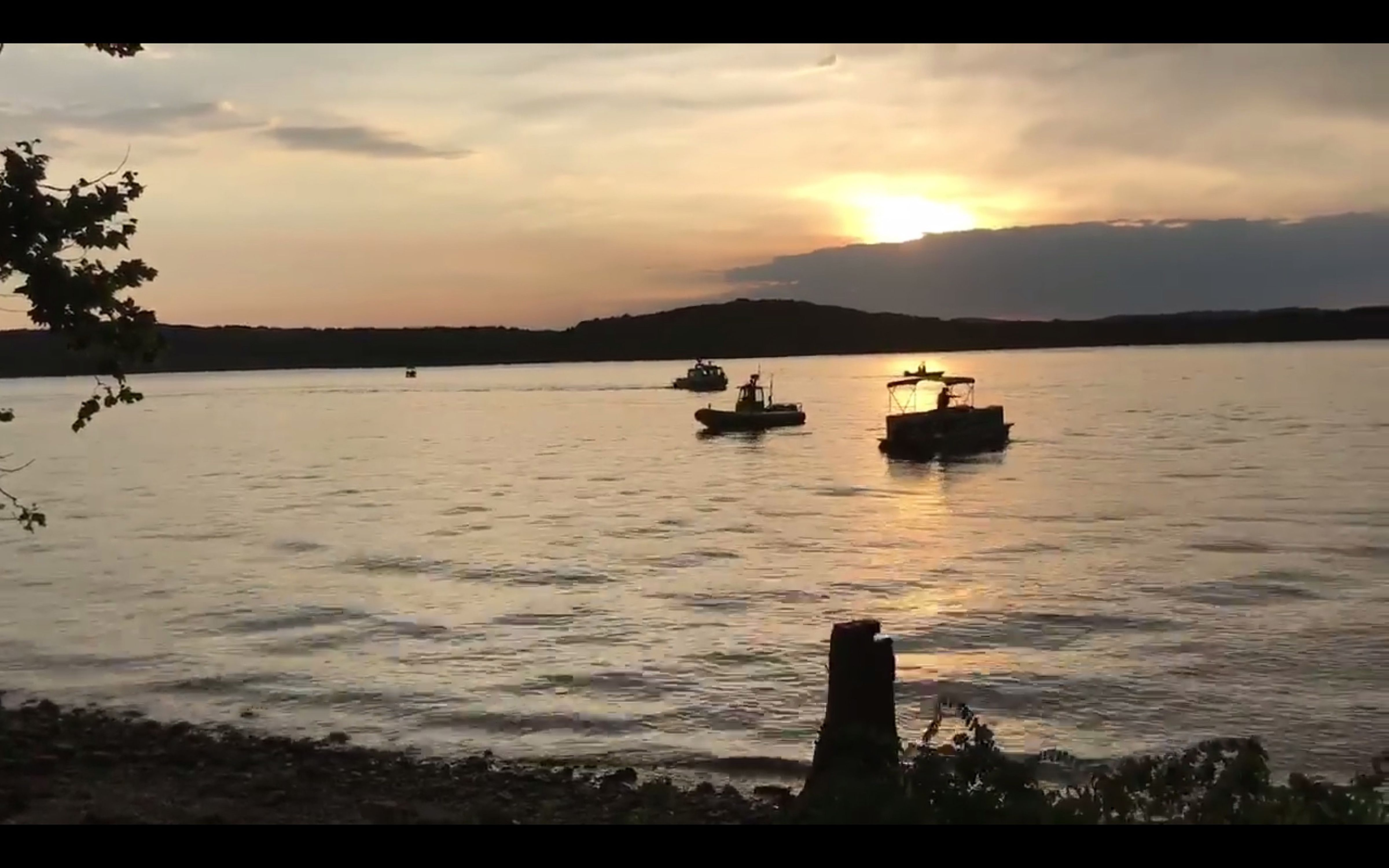 A handout frame grab made available by the Southern Stone County Fire Protection District shows responDing agencies after an amphibious duck boat reportedly capsized on Table Rock Lake in Branson, Missouri on July 19, 2018. According to media reports, at least 11 people were killed, and several others are missing after a Ride the Ducks tourist boat capsized with more than 30 people aboard. Weather conditions are believed to have contributed to the accident.
