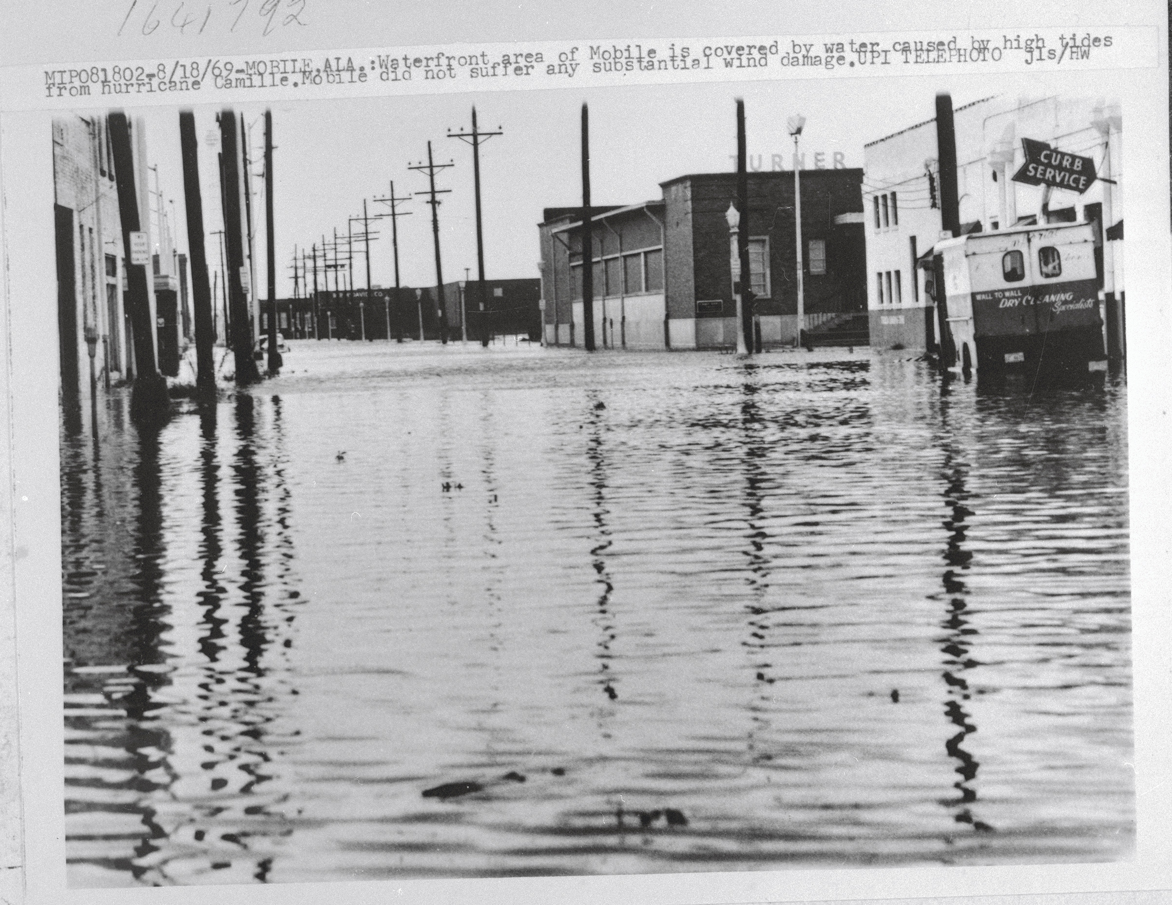 Waterfront area of Mobile is covered by water caused by high tides from hurricane Camille. Mobile did not suffer any substantial wind damage.