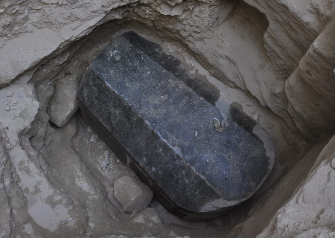 An undated handout photo made available by the Egyptian ministry of Antiquities shows the black granite sarcophagus at the disocvered tomb, Sidi Gaber district, Alexandria. An Egyptian archaeological mission found an ancient tomb dating to the Ptolemaic period (300-35 B.C), as they were inspecting the land before giving authorization for its owner to dig the foundations of a building.