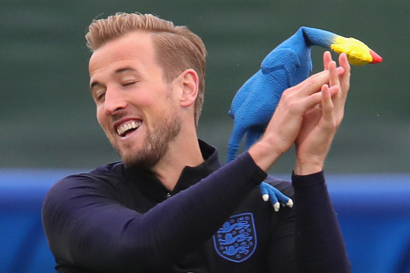 Harry Kane of England catches a toy chicken during the England training session on July 10, 2018 in Saint Petersburg, Russia.
