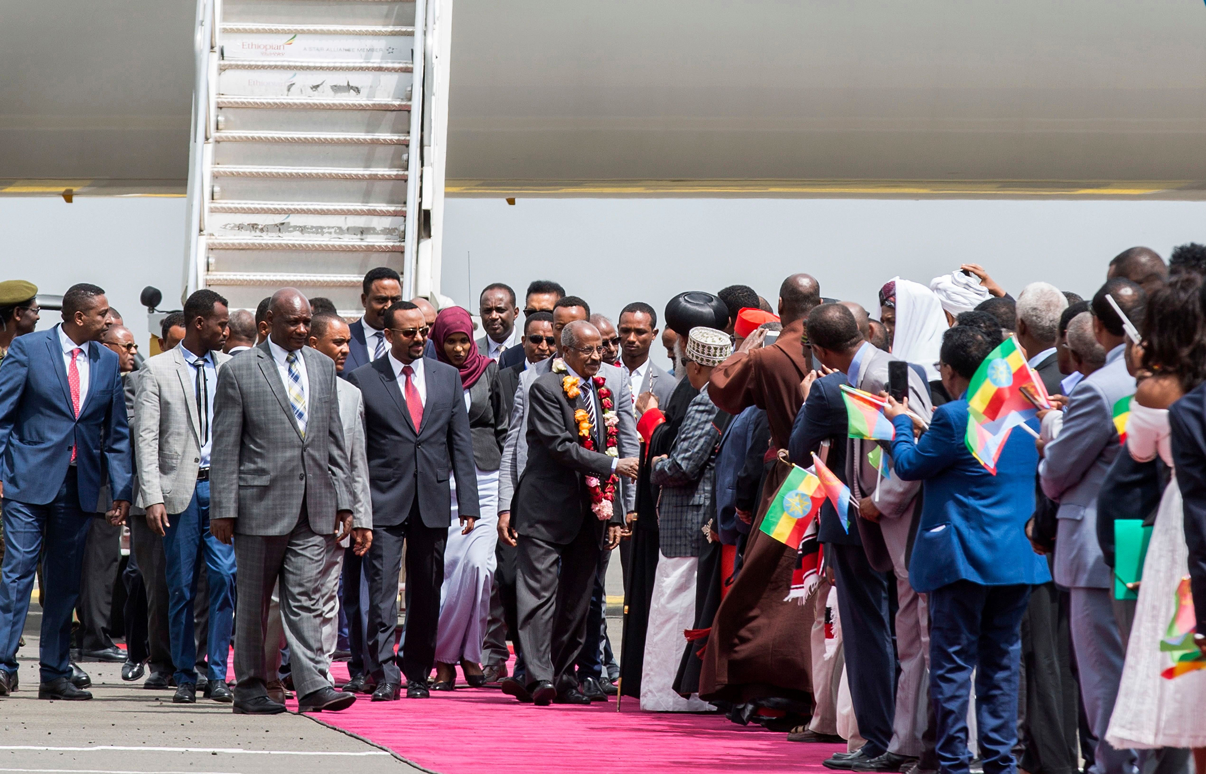 Ethiopia's Prime Minister Abiy Ahmed welcomes an Eritrean delegation in Addis Ababa on June 26, ahead of a Summit where the leaders agreed to end the 20 year war.