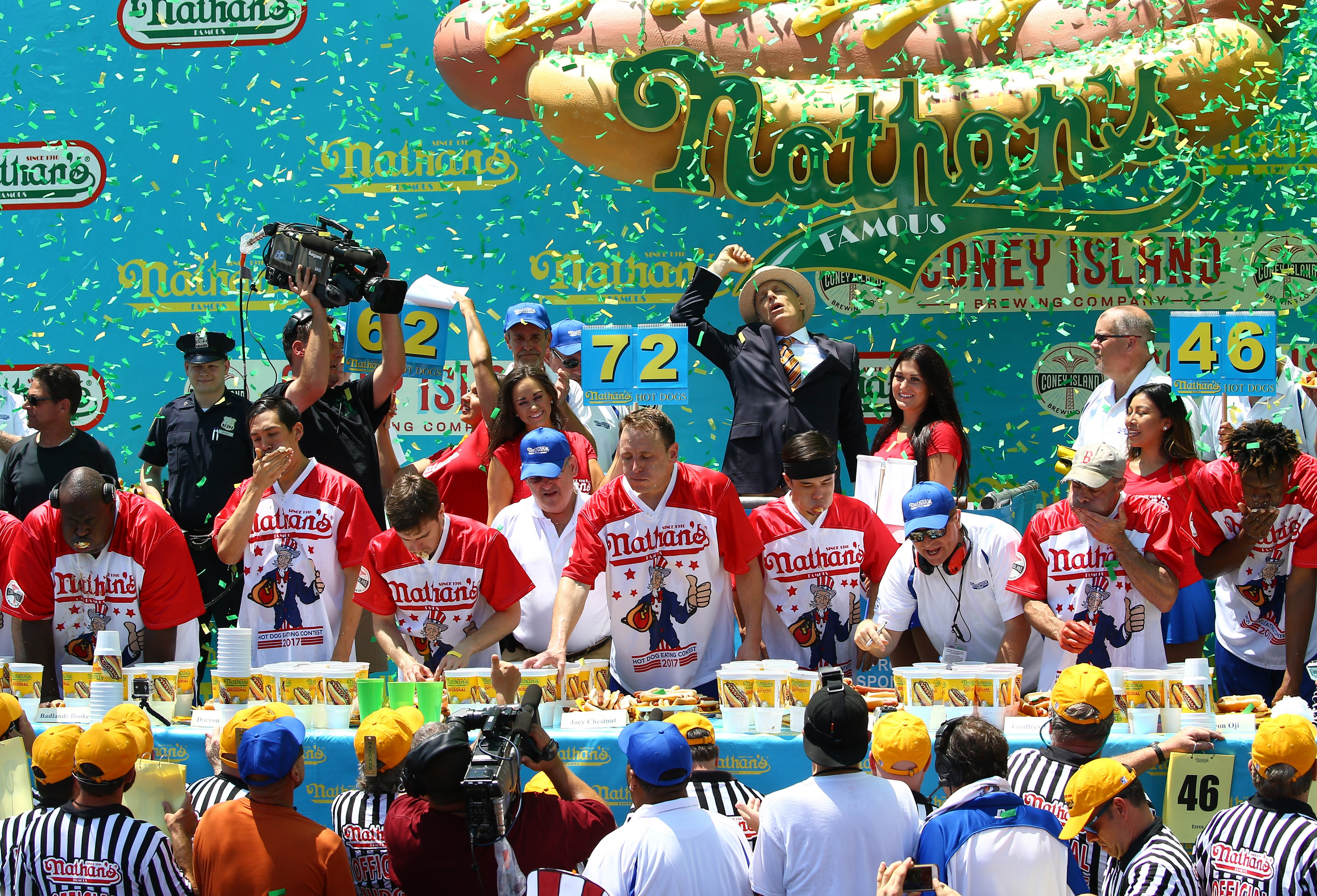 Joey Chestnut (center) wins the men's division of the 2017 Nathan's Famous International Hot Dog Eating Contest at Coney Island, eating 72 hot dogs.