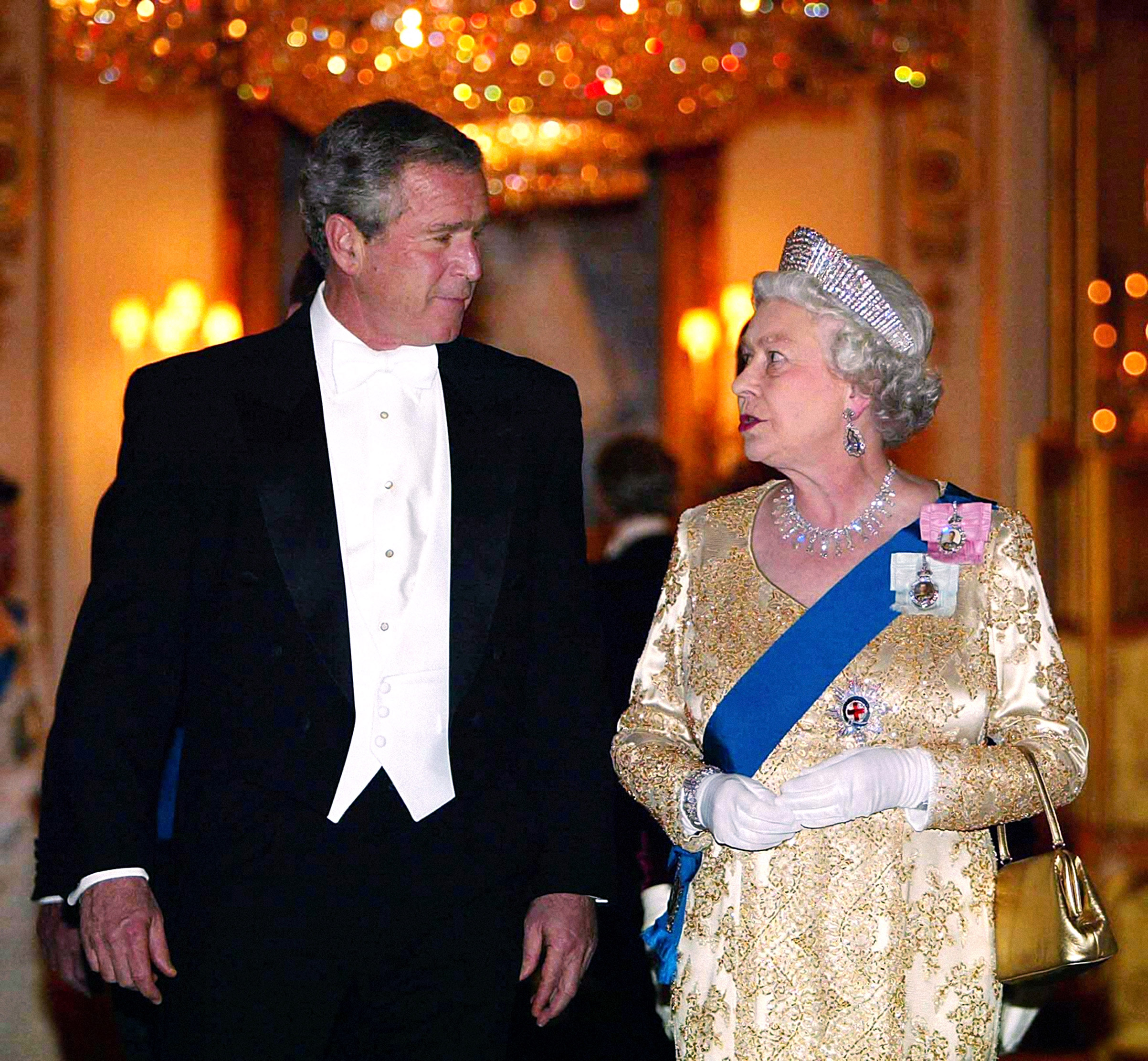 Britain's Queen Elizabeth II arrives with U.S. President George Bush for the Buckingham Palace state banquet in honor of the U.S. President, during the first day of his four-day state visit to the U.K. on Nov. 19, 2003.