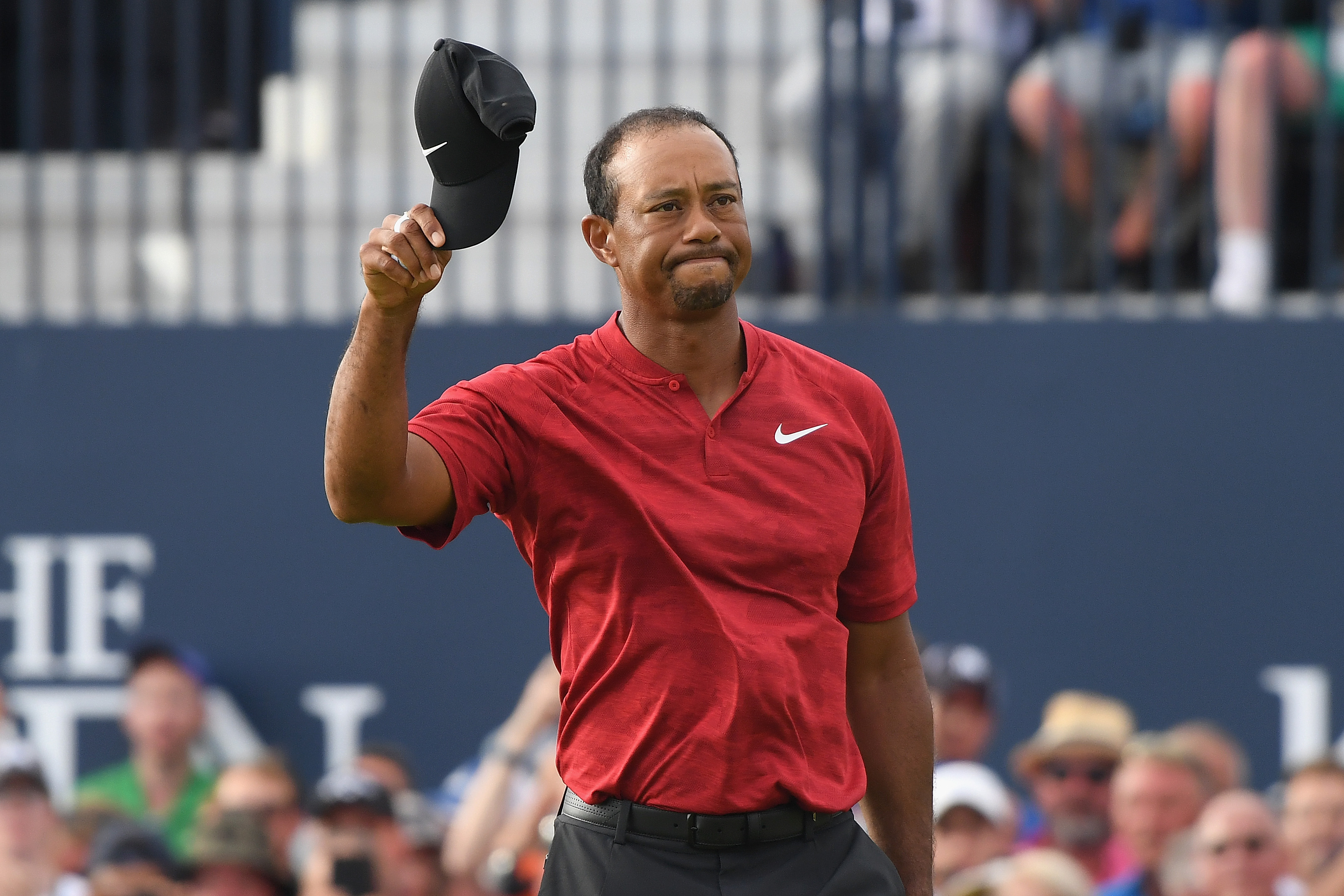 Tiger Woods acknowledges the crowd on the 18th green during the final round of the 147th Open Championship at Carnoustie Golf Club on July 22, 2018 in Carnoustie, Scotland.