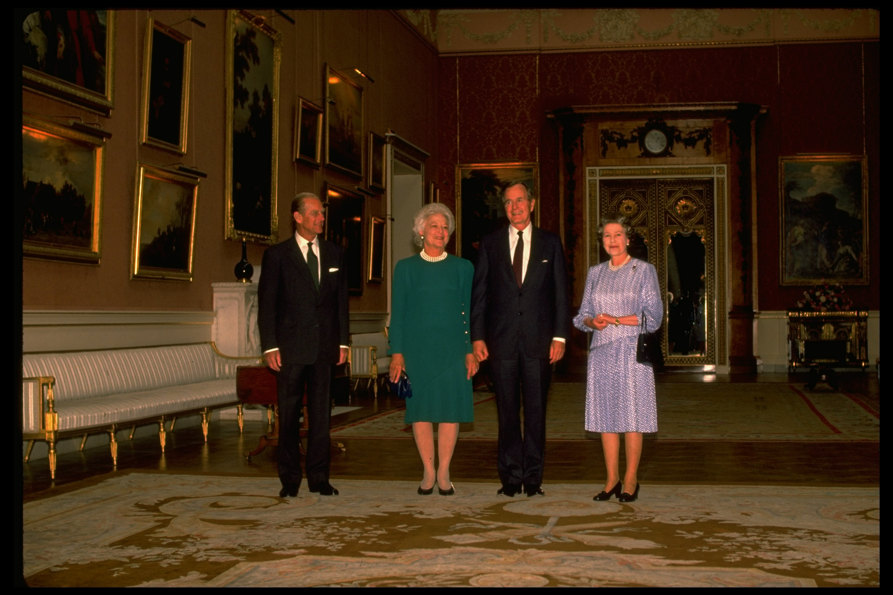 President George H. W. Bush and signature-pearls-sporting Barbara Bush with. Queen Elizabeth II & Prince Philip, at Buckingham Palace, London, England on June 1, 1989