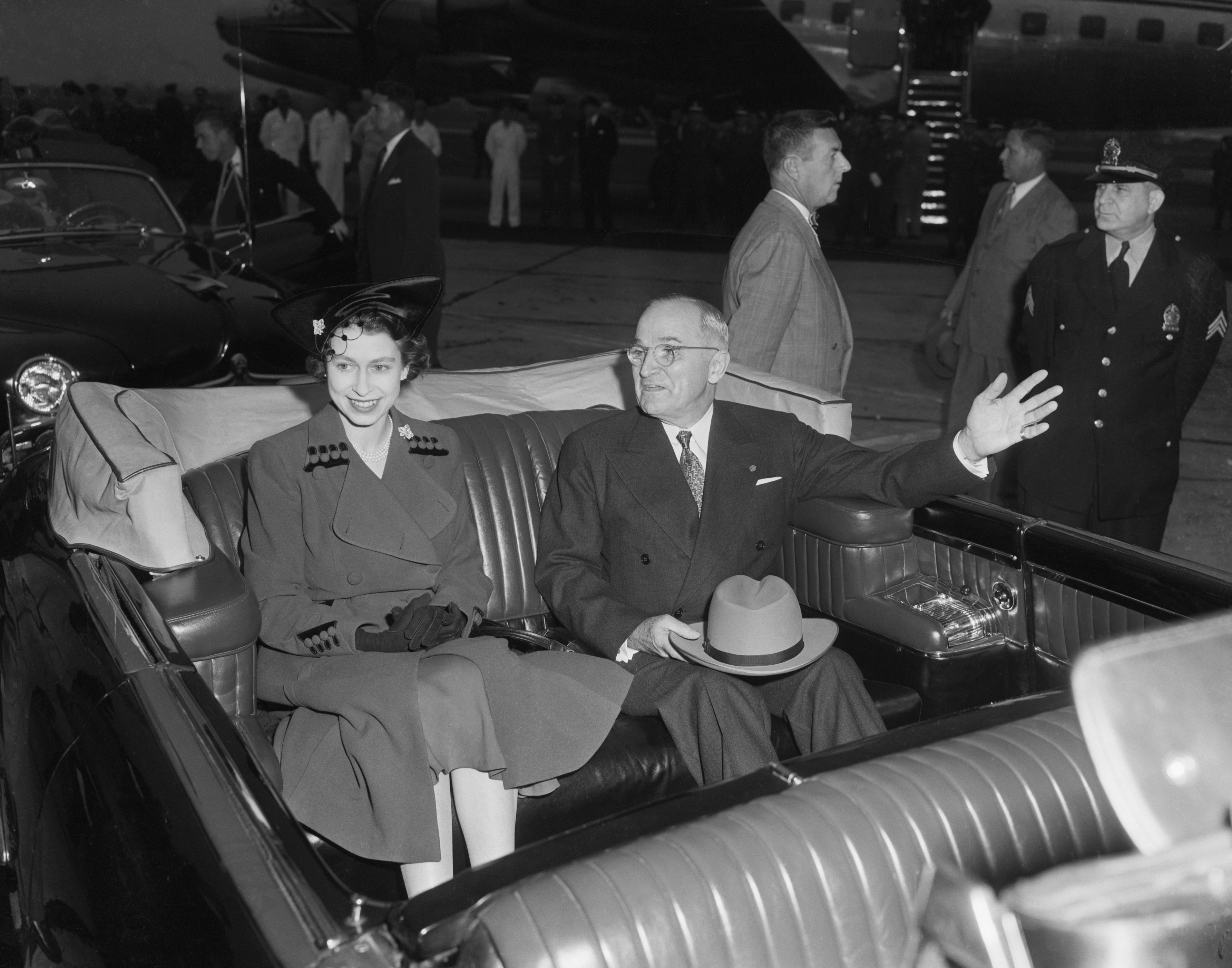President Harry S. Truman and Britain's Princess Elizabeth are shown as their motorcade got underway following the reception ceremony at Washington National Airport on October 31, 1951.