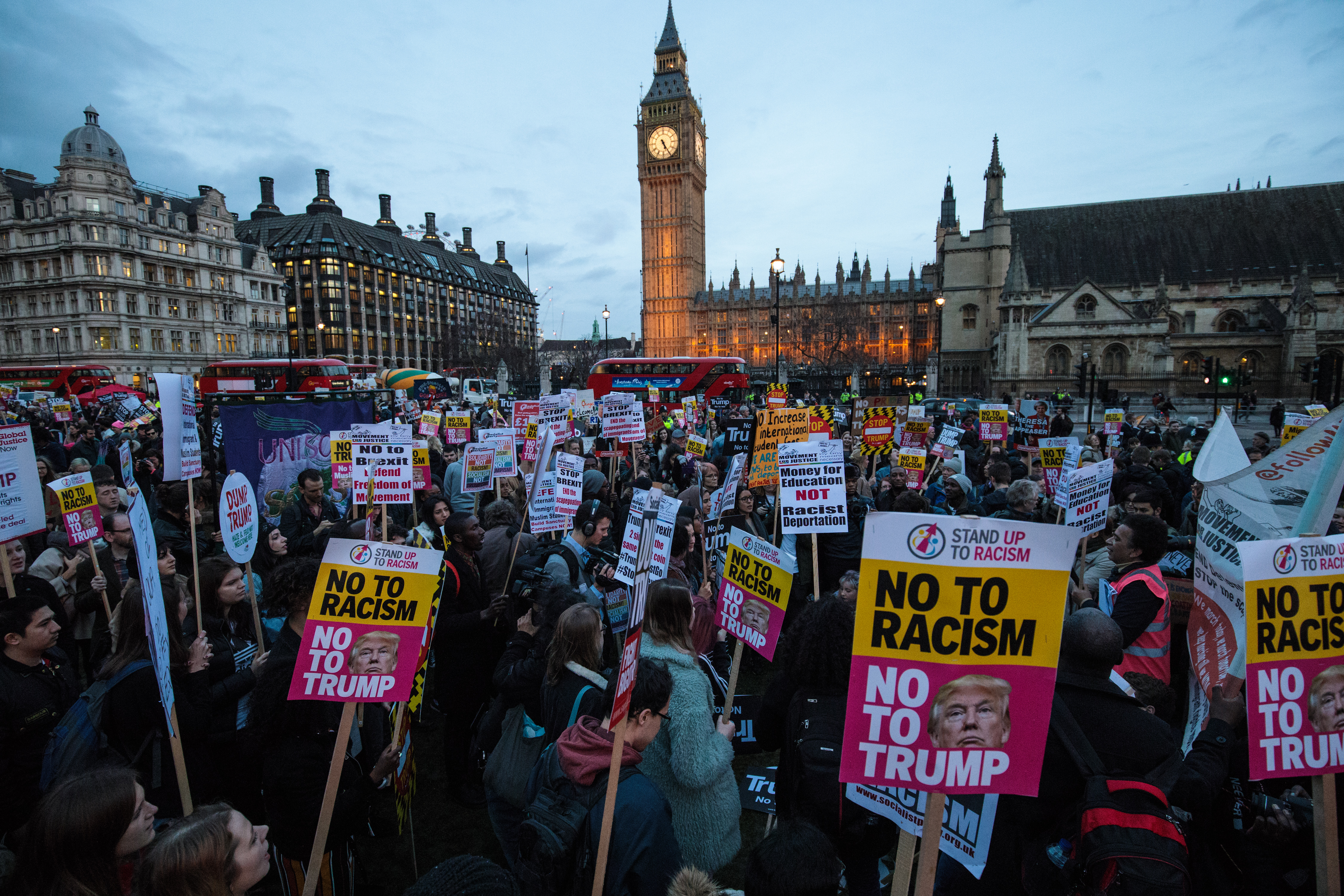 Protesters holding placards take part in a rally in Parliament Square against U.S. president Donald Trump's state visit to the UK on February 20, 2017 in London, England.