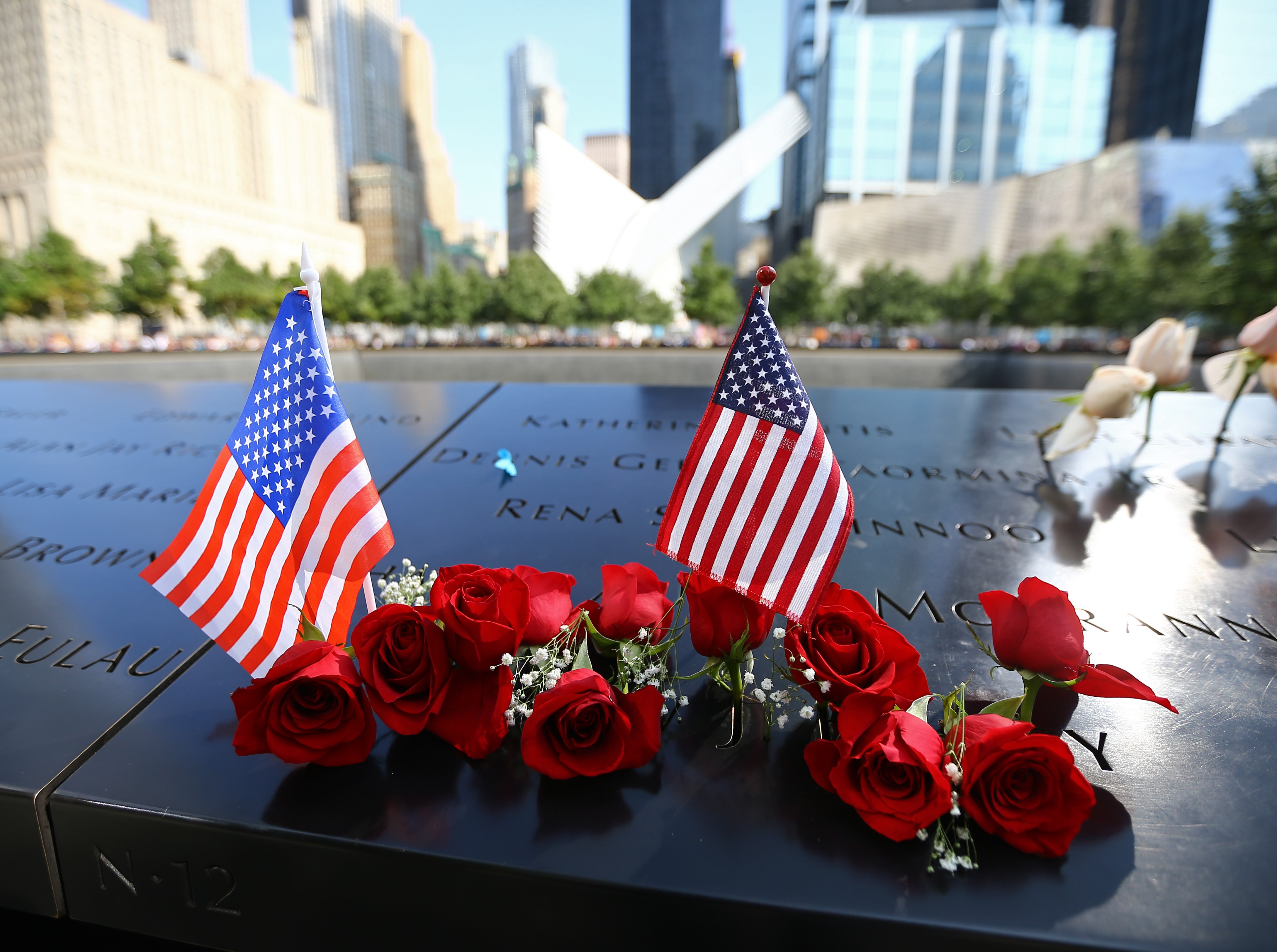 Flowers are placed over the monument for 9/11 victims on the 16th anniversary in Manhattan, New York, on Sept. 11, 2017.