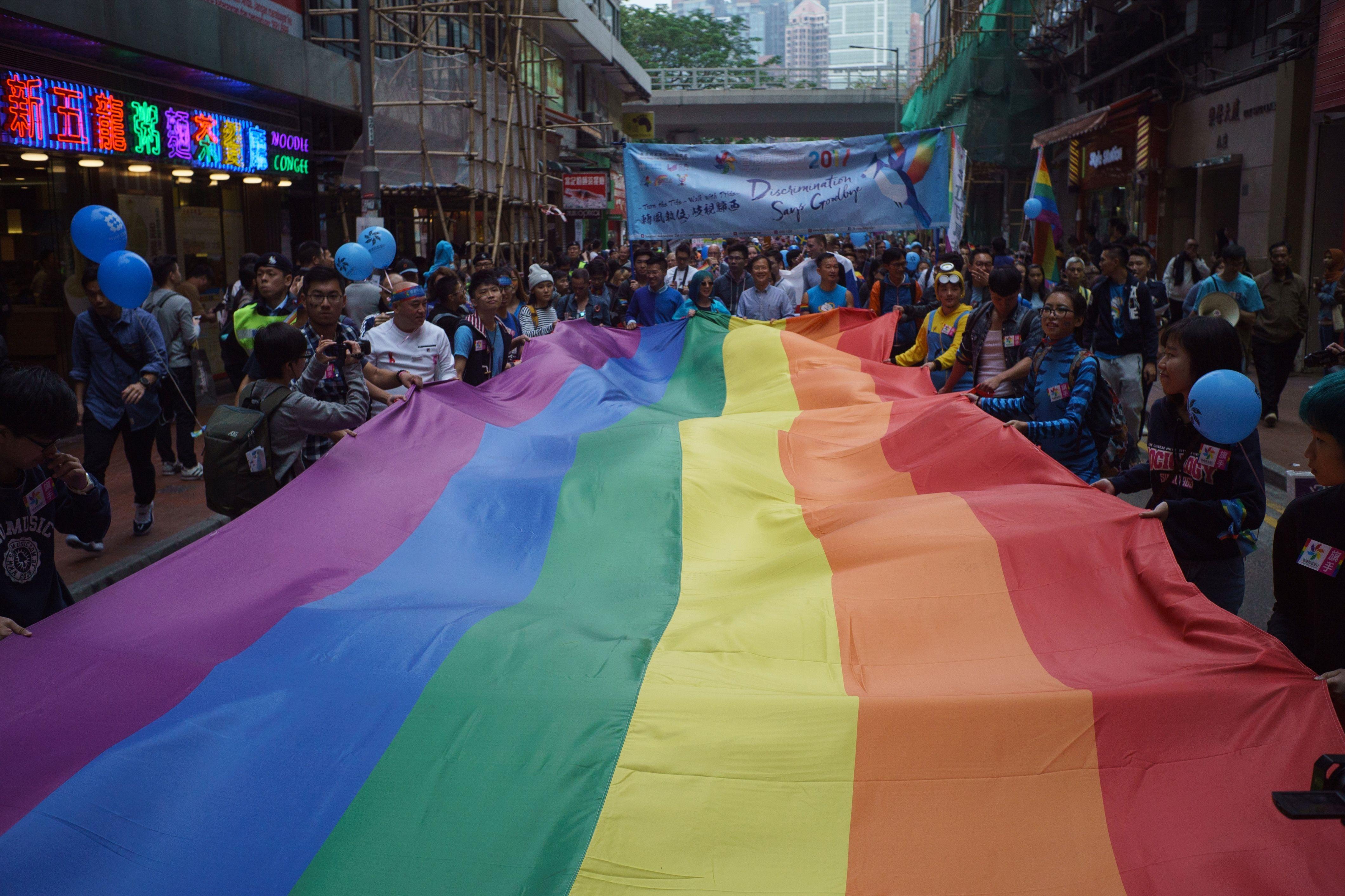 A giant rainbow flag is displayed during Hong Kong's annual pride parade on Nov. 25, 2017.