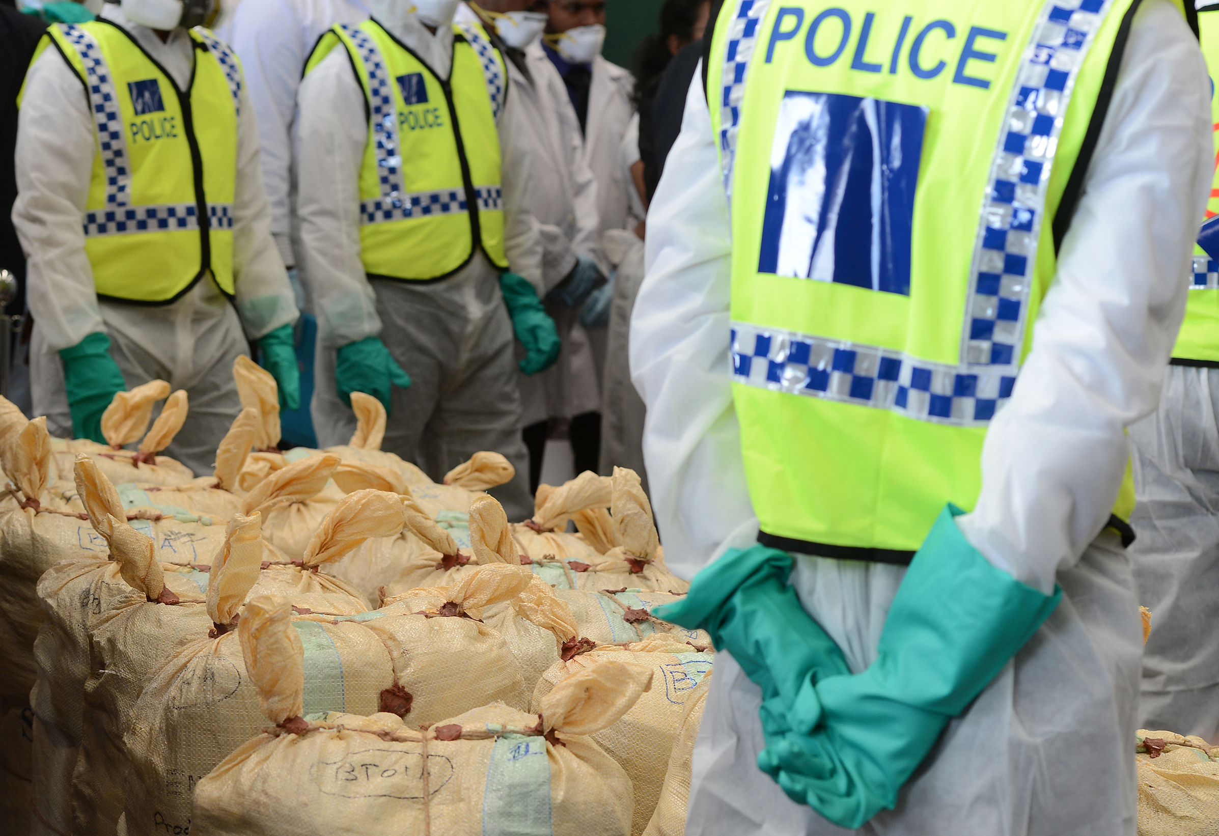 Sri Lankan police personnel prepare seized cocaine to be destroyed under judicial supervision in Katunayake on January 15, 2018.