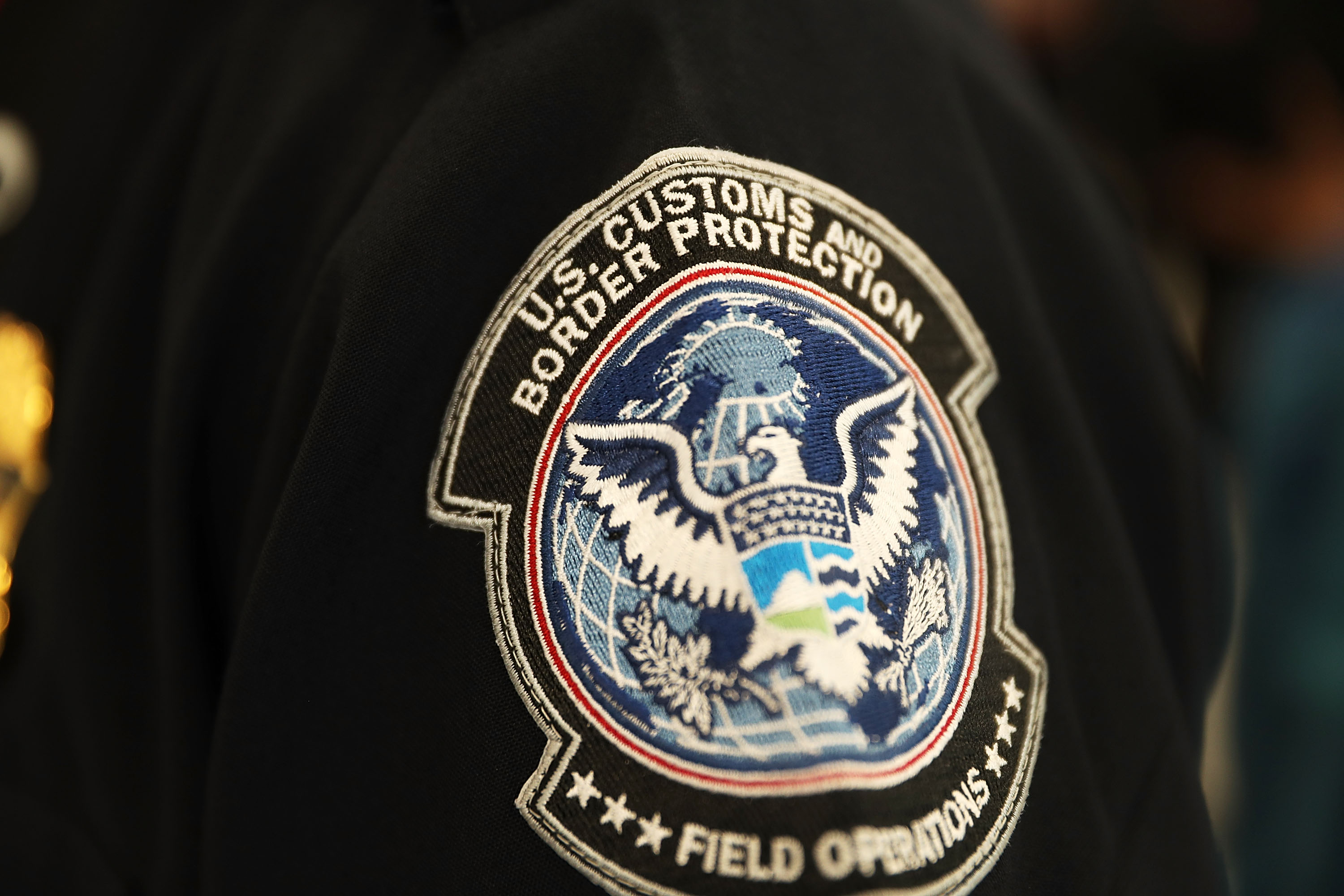 A patch is seen on the sleeve of a U.S. Customs and Border Protection officer at Miami International Airport on Feb. 27, 2018 in Miami, Florida.