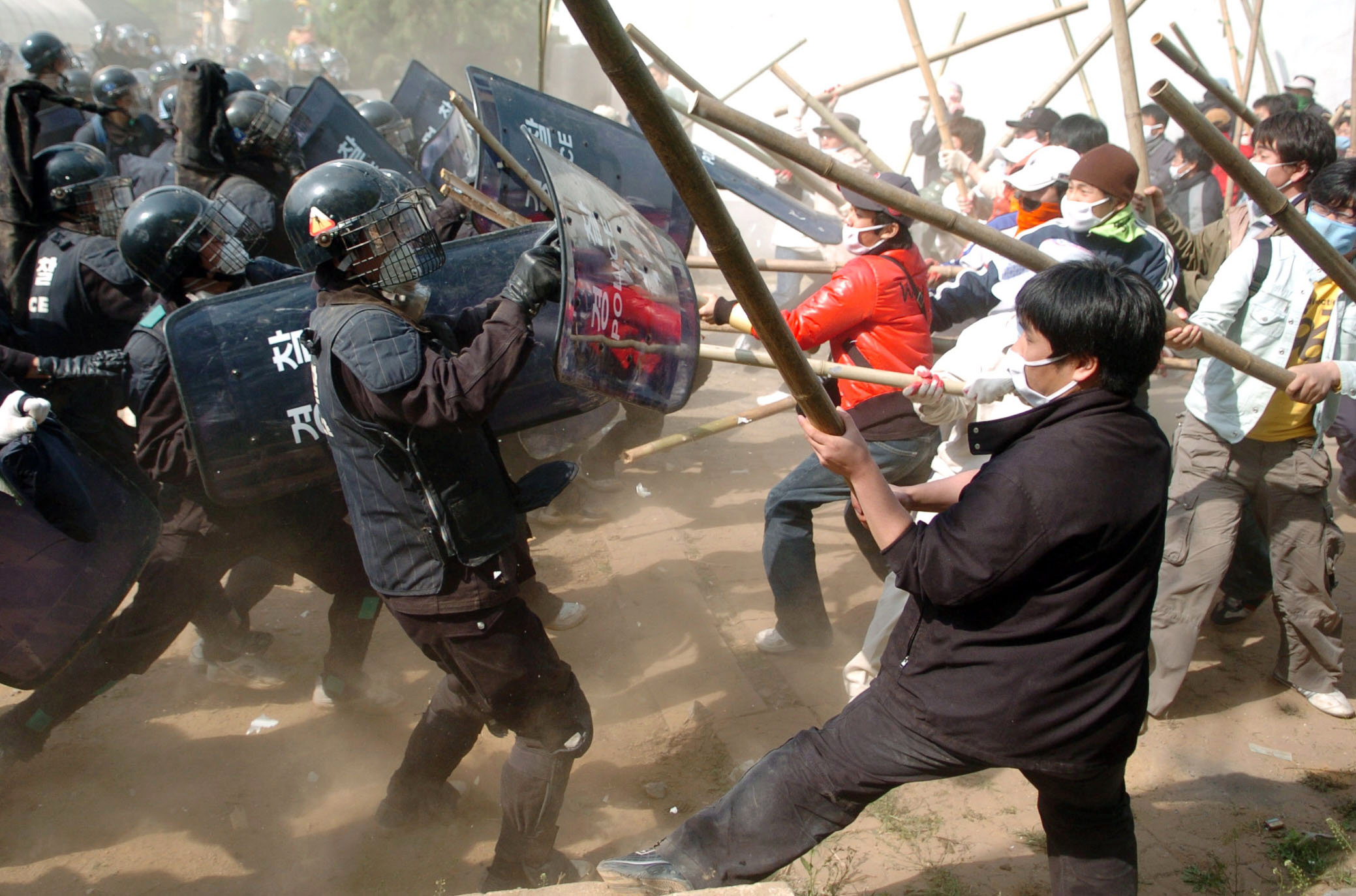 South Korean riot police break up a protest in Pyeongtaek, South Korea, near the U.S. military facility Camp Humphreys, on May 4, 2006.