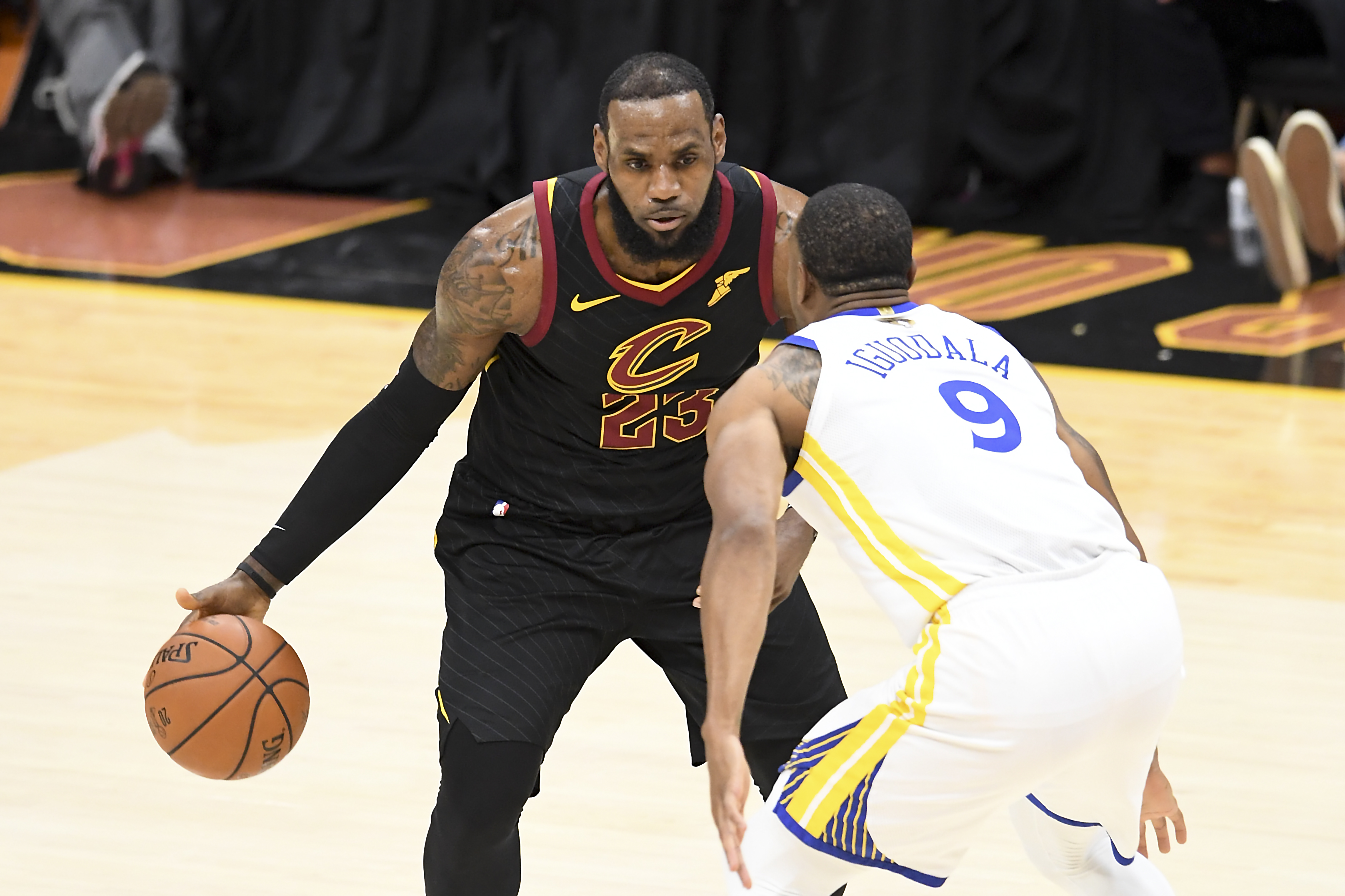 LeBron James #23 of the Cleveland Cavaliers defended by Andre Iguodala #9 of the Golden State Warriors in the first half during Game Four of the 2018 NBA Finals at Quicken Loans Arena on June 8, 2018 in Cleveland, Ohio.