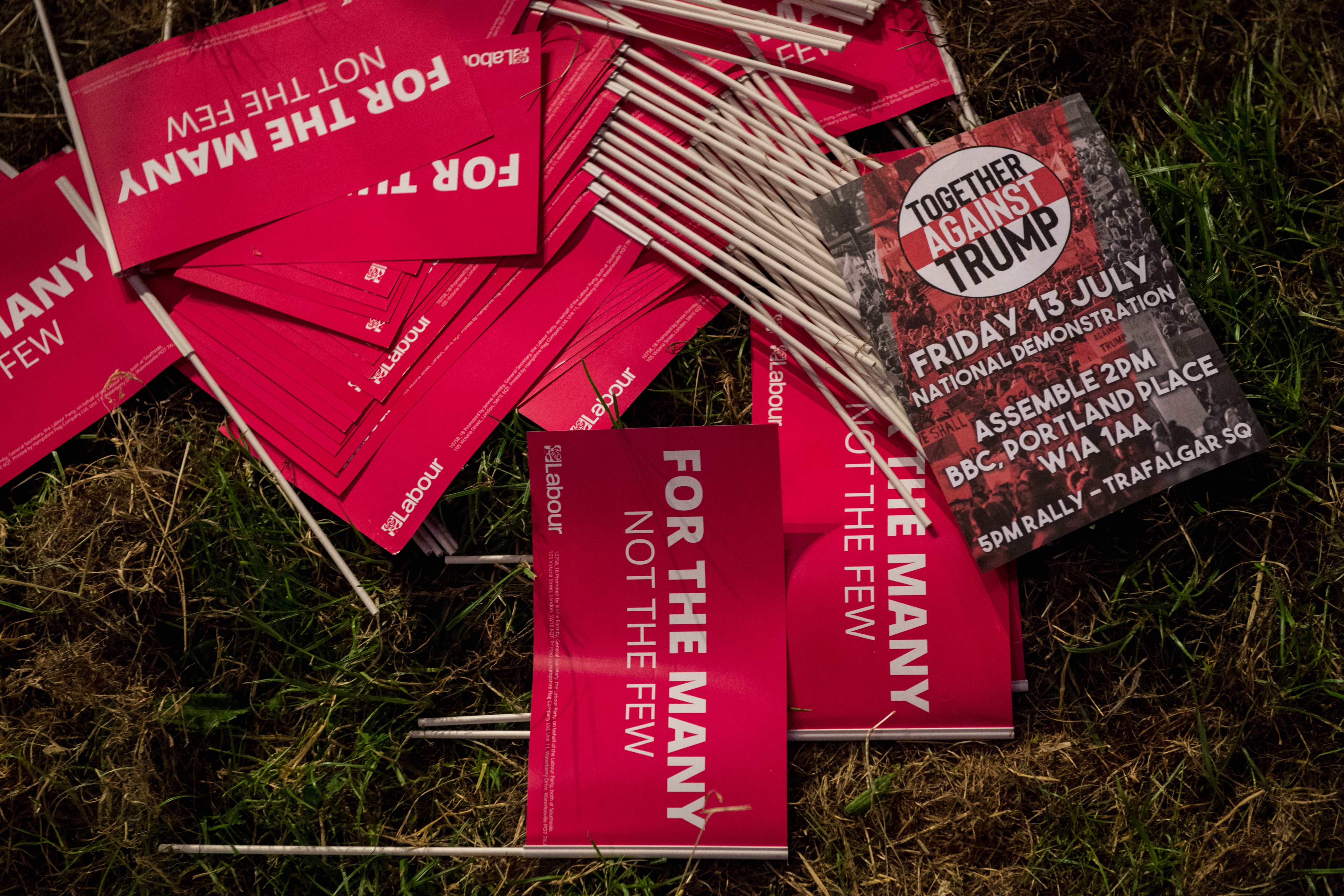 A leaflet for a protest against Donald Trump is seen among Labour party flags at the Solidarity Tent at Labour Live, White Hart Lane, Tottenham on June 16, 2018 in London, England.