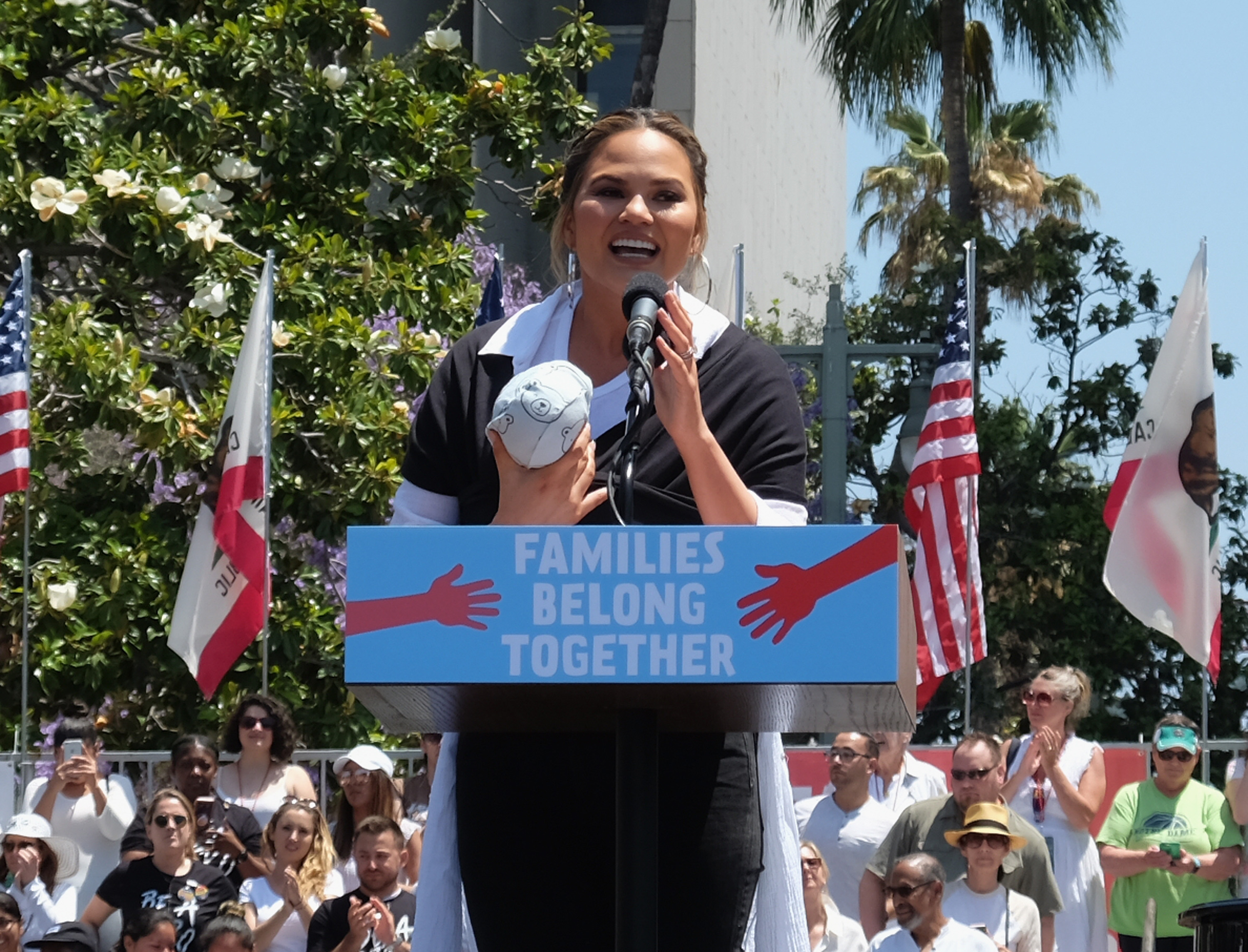LOS ANGELES, CA - JUNE 30:  Chrissy Teigen speaks at the Families Belong Together - Freedom For Immigrants March at Los Angeles City Hall on June 30, 2018 in Los Angeles, California.  (Photo by Sarah Morris/Getty Images)