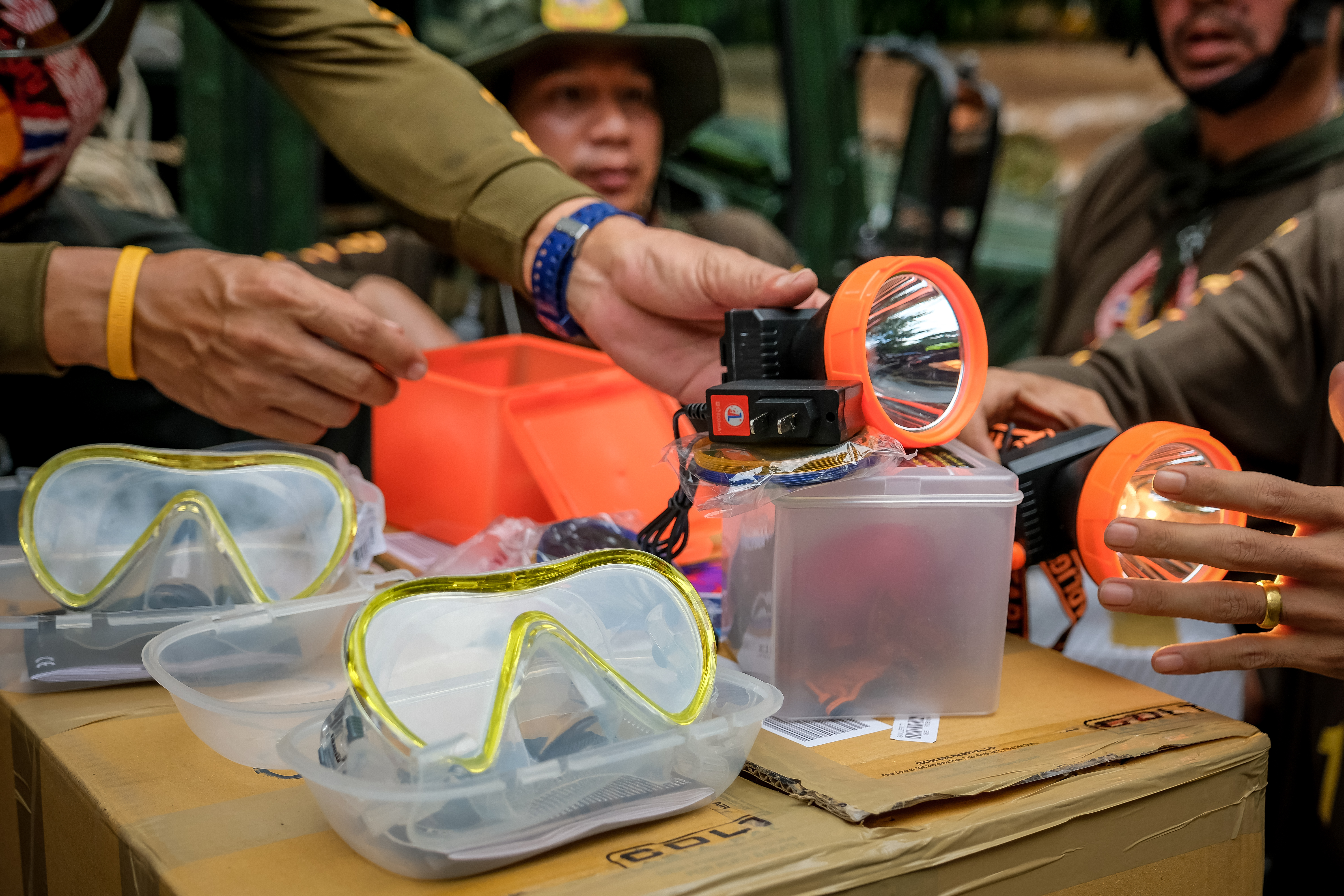 Rescuer workers prepare small diving mask to deliver inside Tham Luang Nang Non cave to continue the rescue operation on July 4, 2018 in Chiang Rai, Thailand.
