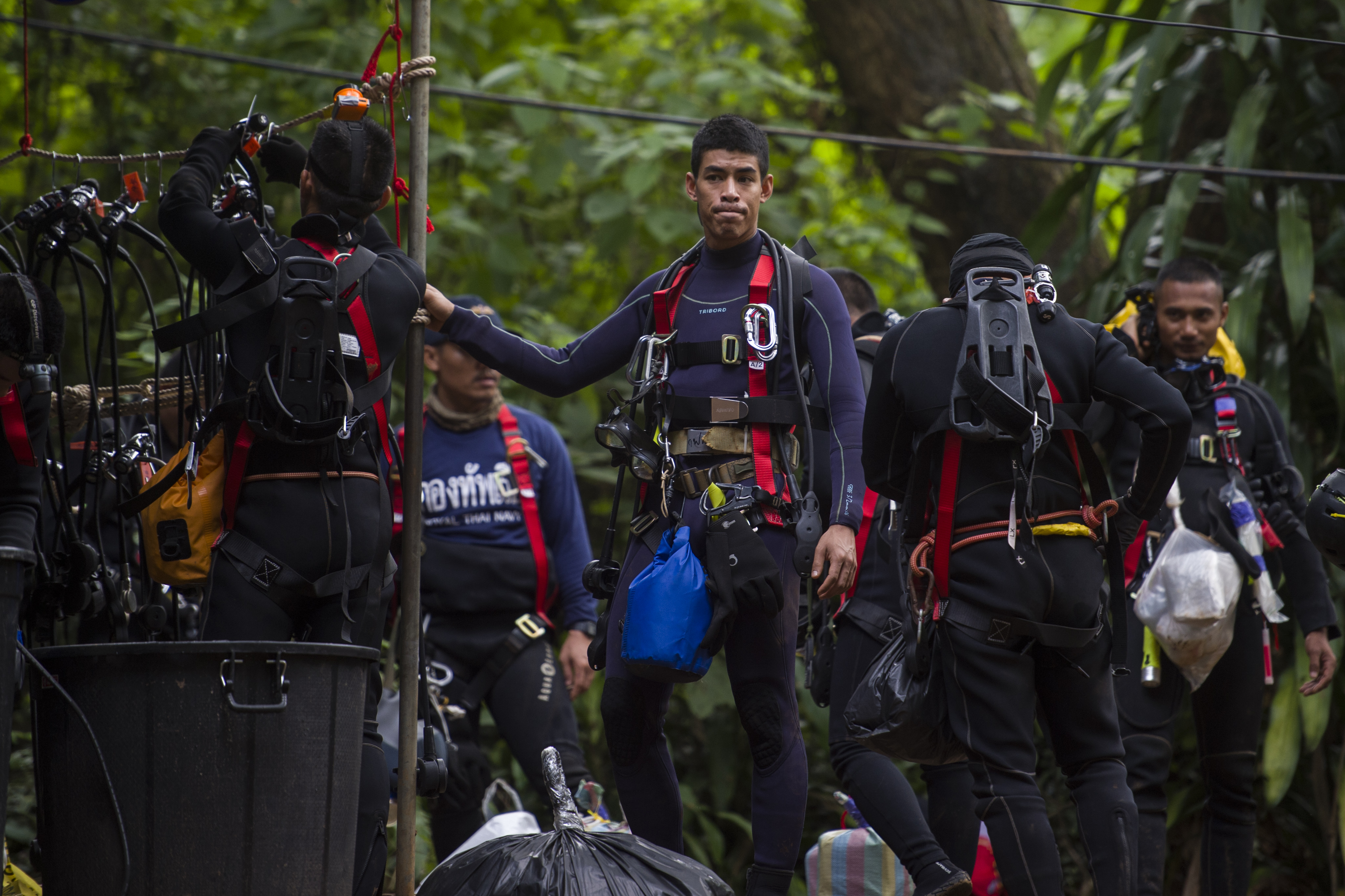 Thai divers carry supplies as rescue operations continued for 12 boys and their coach trapped at Tham Luang cave at in the Mae Sai district of Chiang Rai province on July 5, 2018. The team has been successfully rescued.