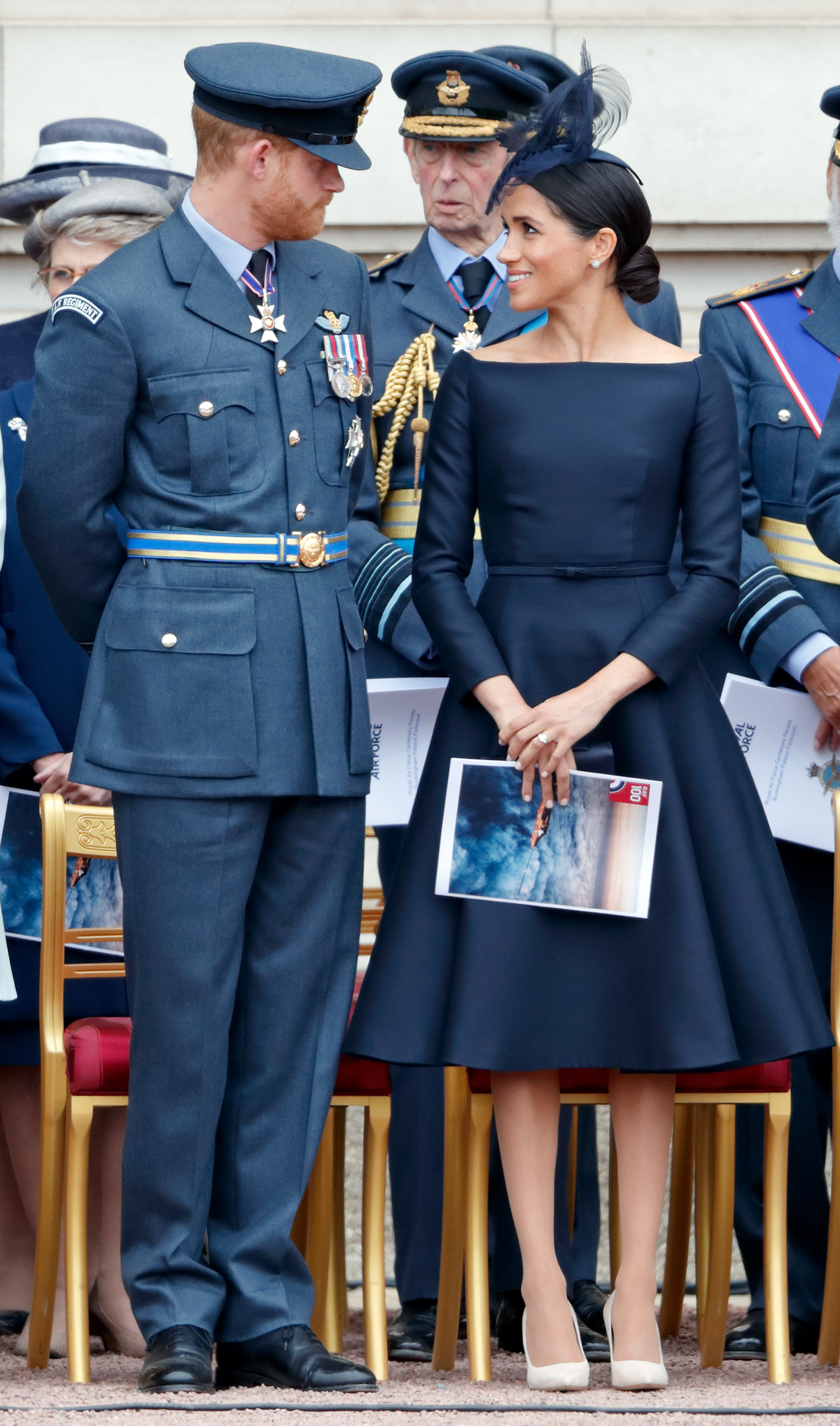 Prince Harry, Duke of Sussex and Meghan, Duchess of Sussex attend a ceremony to mark the centenary of the Royal Air Force on the forecourt of Buckingham Palace on July 10, 2018 in (Photo by Max Mumby/Indigo/Getty Images)