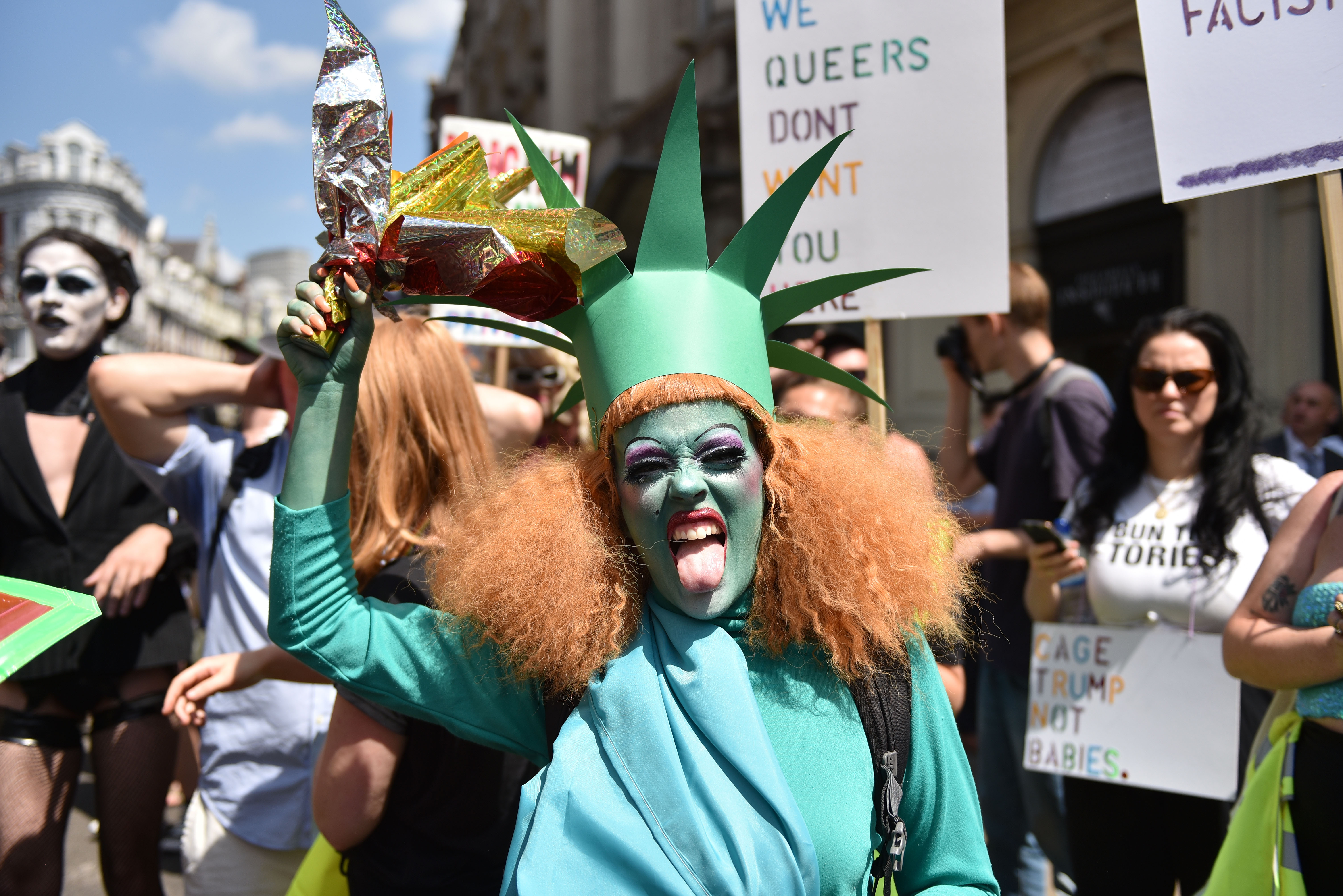 LONDON, UNITED KINGDOM - JULY 13:  A demonstrator dressed as the statue of Liberty attends the Drag Protest Parade LGBTQi March against Trump on July 13, 2018 in London, United Kingdom. Drag queens hold a mass rally in Central London against the Trump administration?s record on LGBT rights including a ban on transgender personnel. The President of the United States and First Lady, Melania Trump, touched down yesterday in the UK on Air Force One for their first official visit. Today the President will visit Prime Minister Theresa May at Chequers and take tea with the Queen at Windsor Castle.  (Photo by John Keeble/Getty Images)