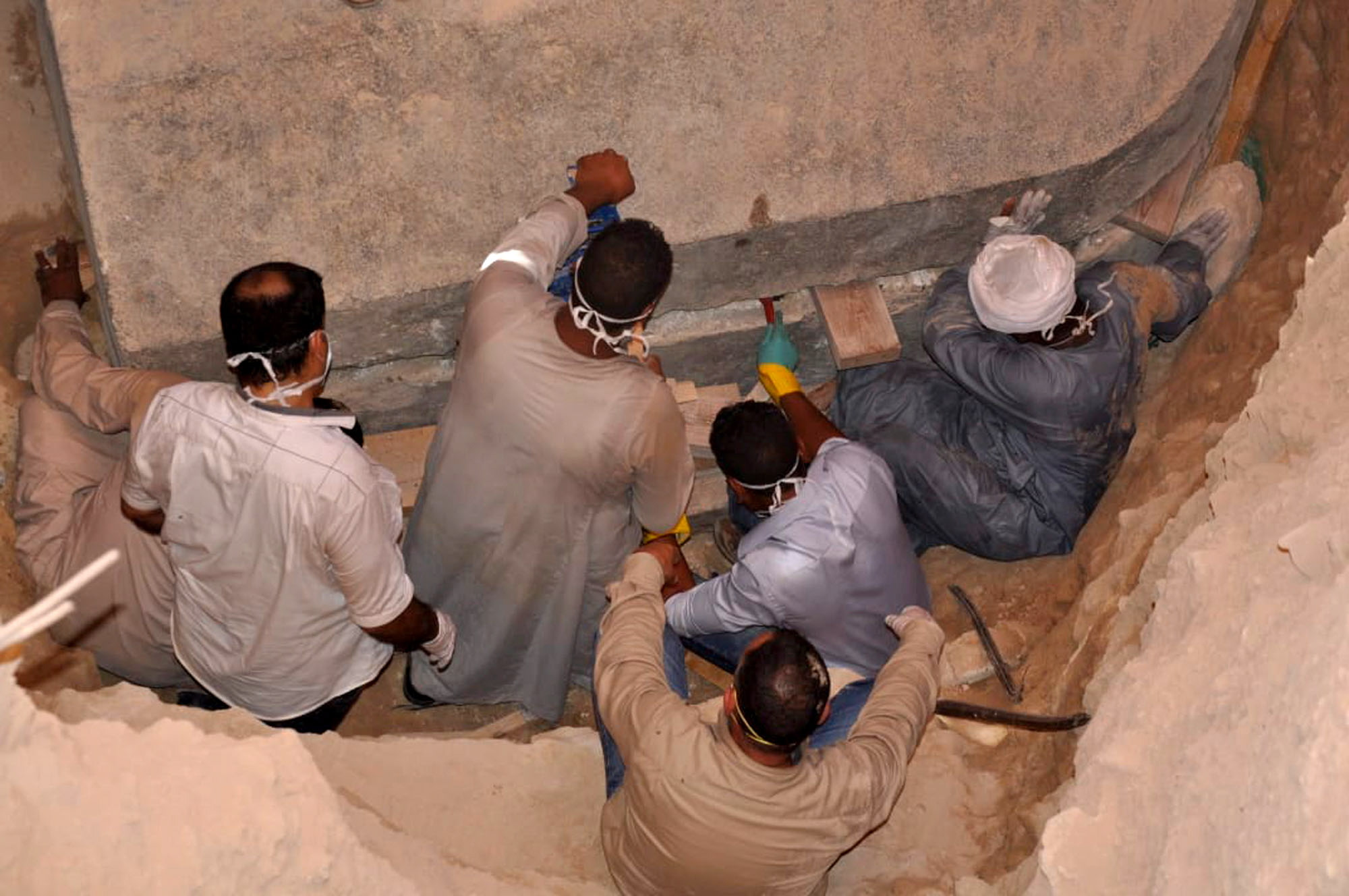 A handout photo made available by the Egyptian Ministry of Antiquities shows workers preparing to open the black granite sarcophagus that was discovered in Sidi Gaber district, Alexandria, Egypt, 19 July 2018.