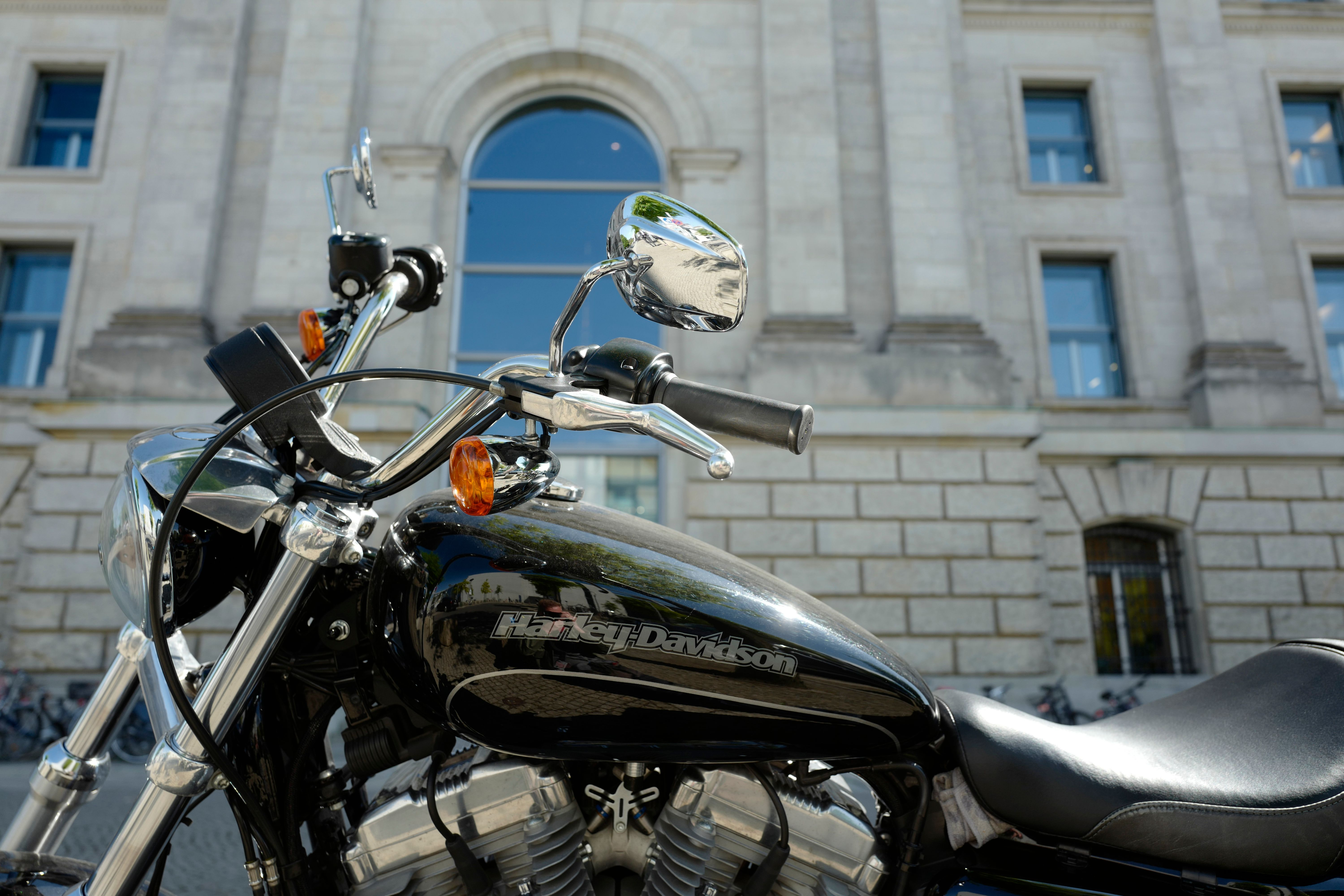 A picture taken on June 26, 2018 shows a Harley-Davidson motorbike parked in front of the Reichstag building which houses Germany's Bundestag lower house of parliament.