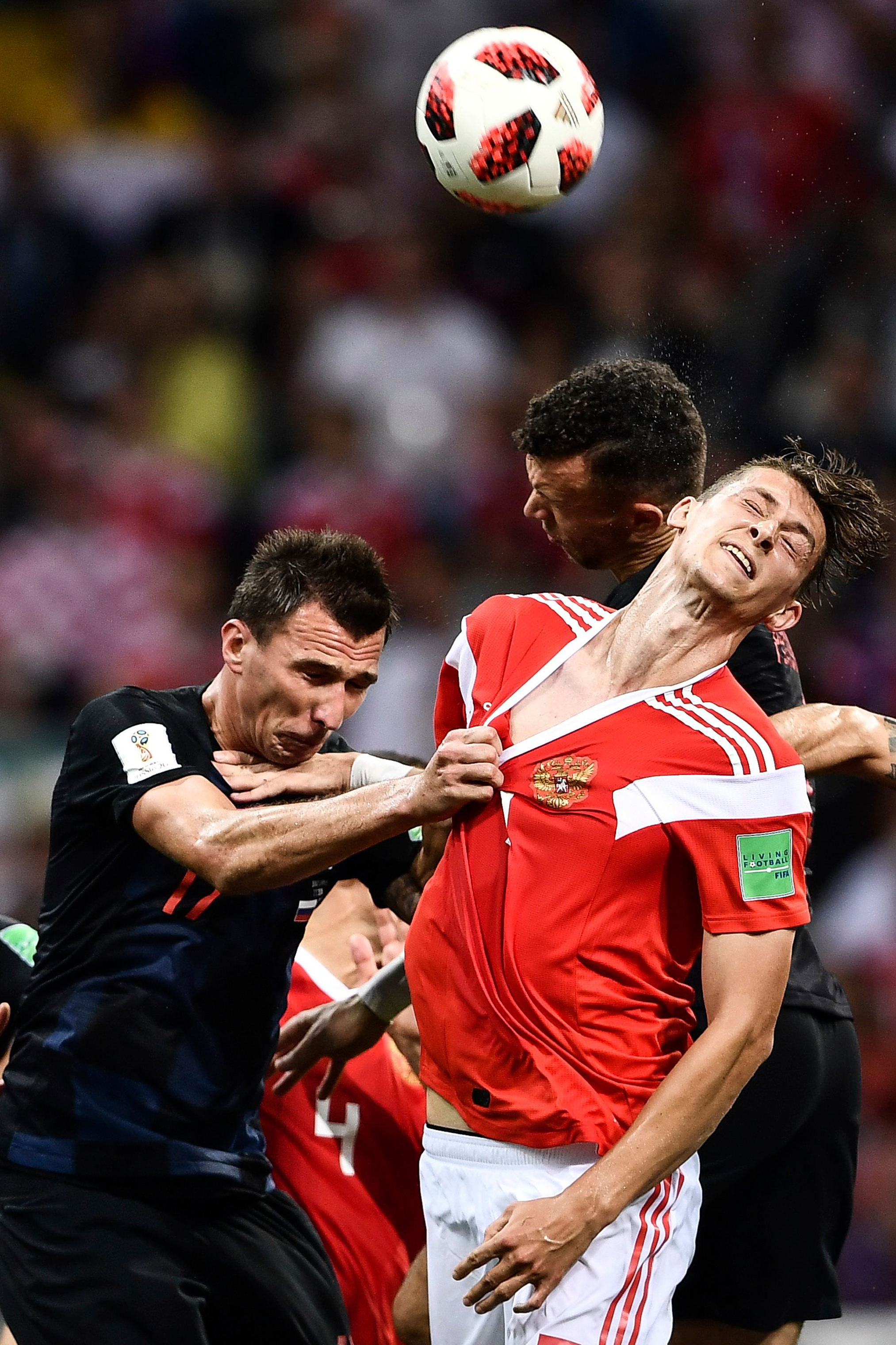 Aleksandr Golovin of Croatia, left, challenges a Russian player in their quarterfinal match on July 7, 2018.