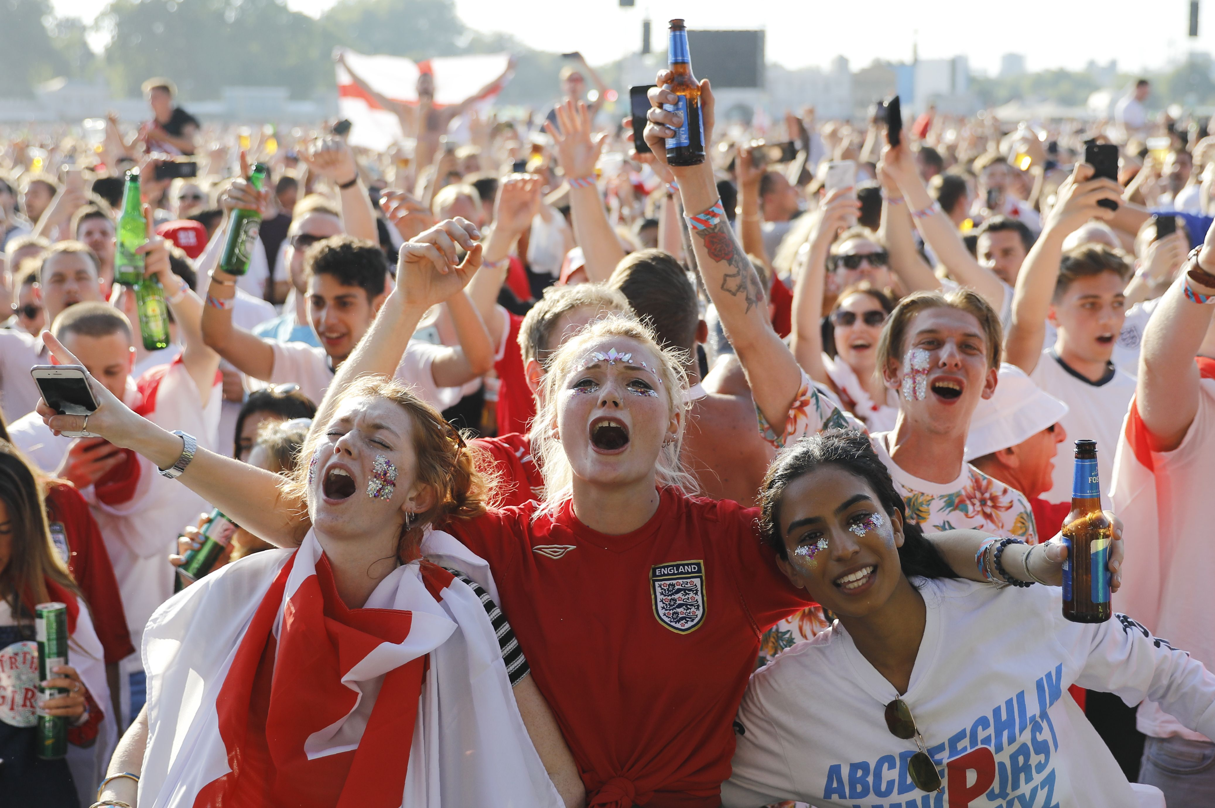 England supporters arrive at an outdoor screen in Hyde Park in central London to watch England the 2018 World Cup semi-final between England and Croatia in Moscow on July 11, 2018.