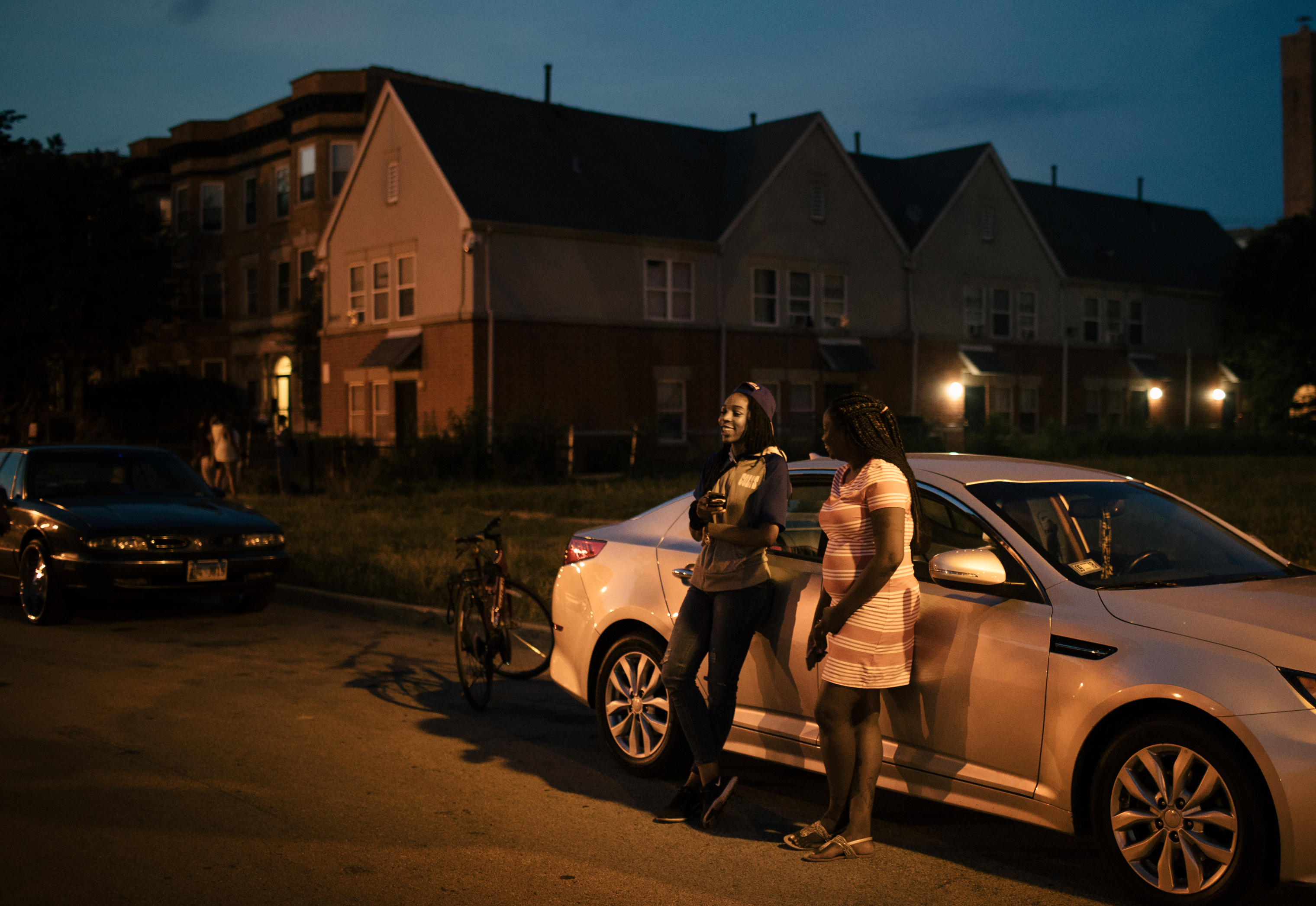 From left, Shawn-Tae, who asked to be identified only by her first name, and Sterling Okafor enjoy an evening together in the Woodlawn neighborhood on Chicago's South Side.