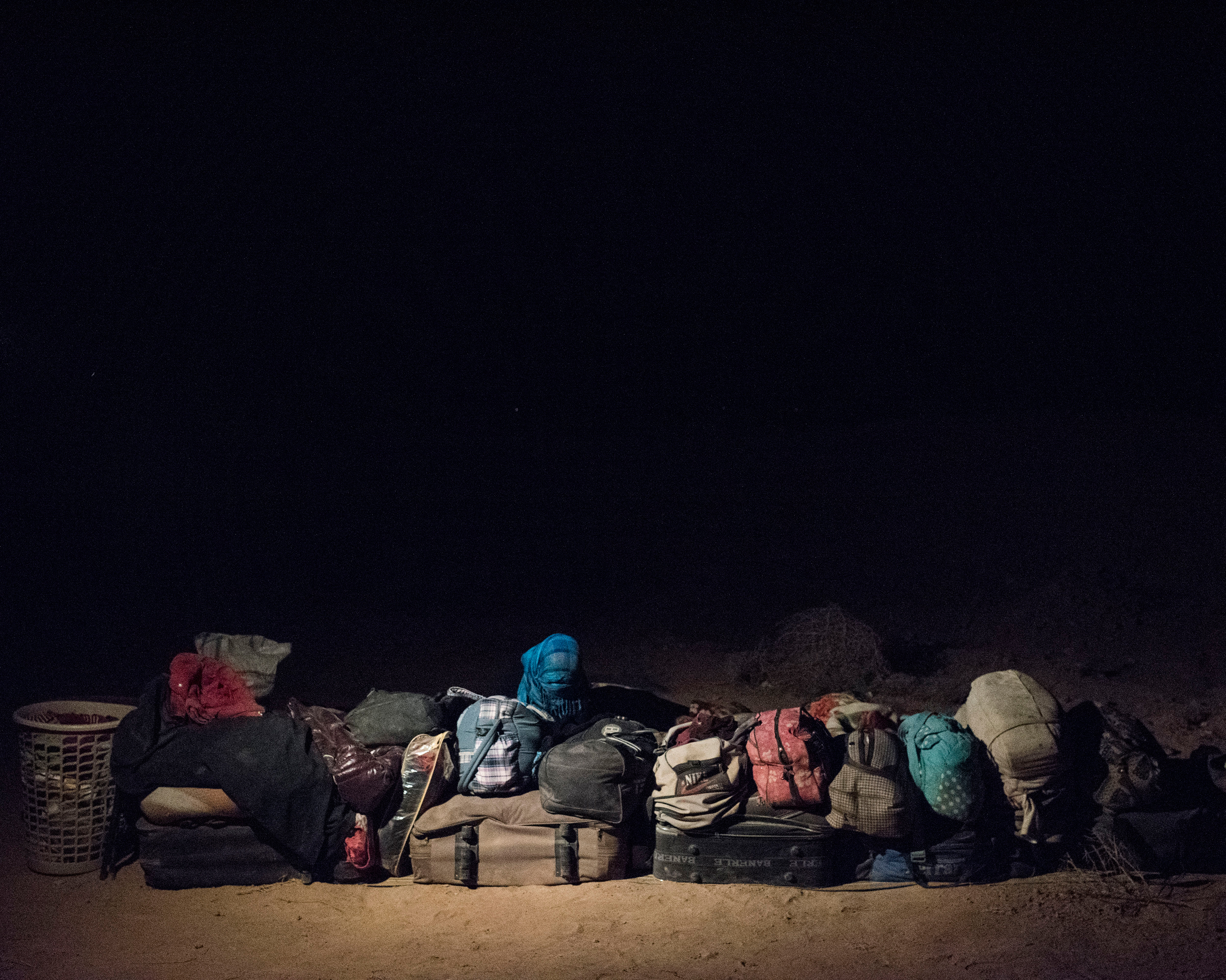 The belongings of refugees sleeping in the Syrian desert, on the outskirts of Deir ez-Zor.