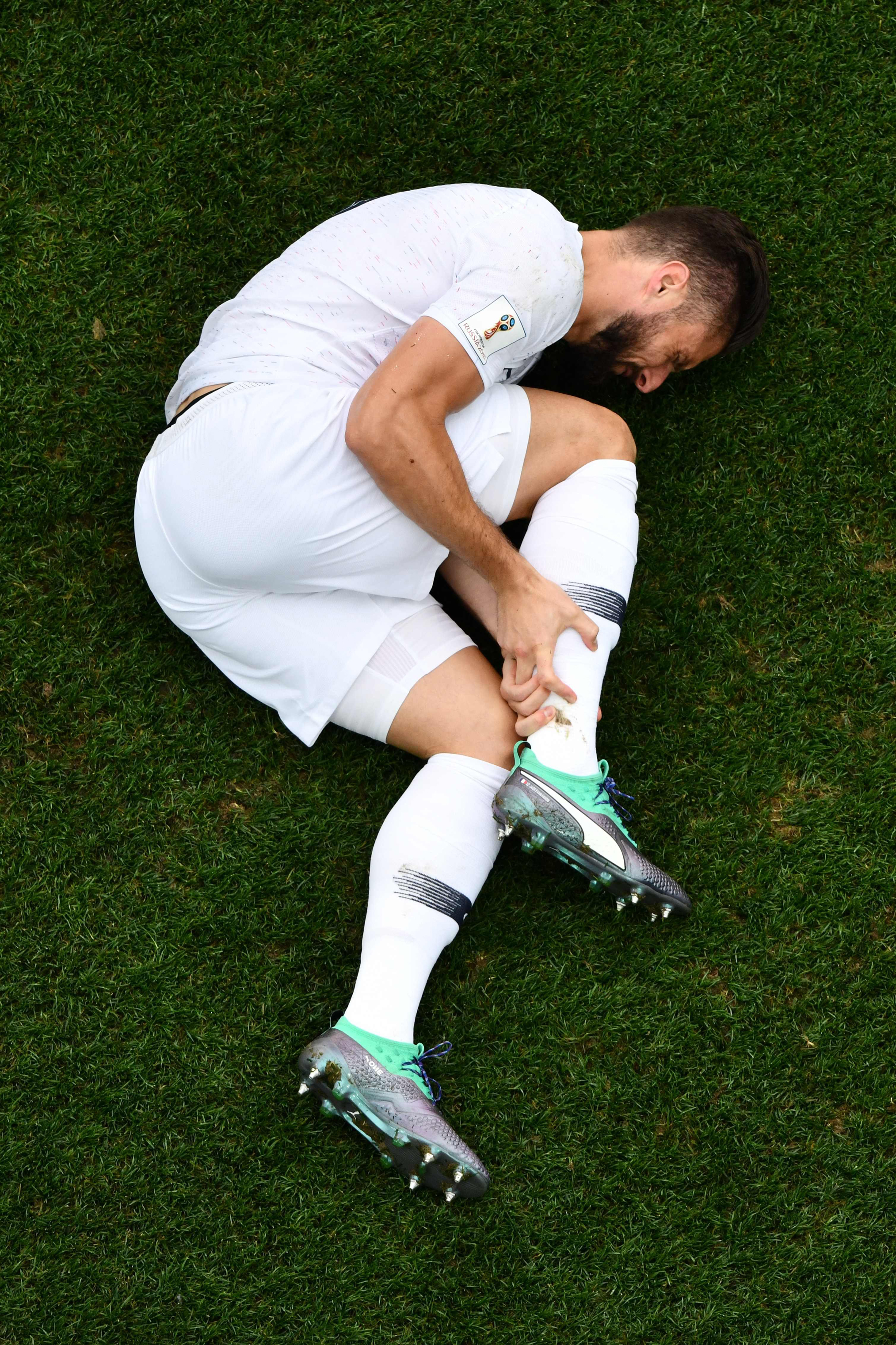 France's forward Olivier Giroud reacts after a challenge during the quarter-final football match between Uruguay and France on July 6, 2018.