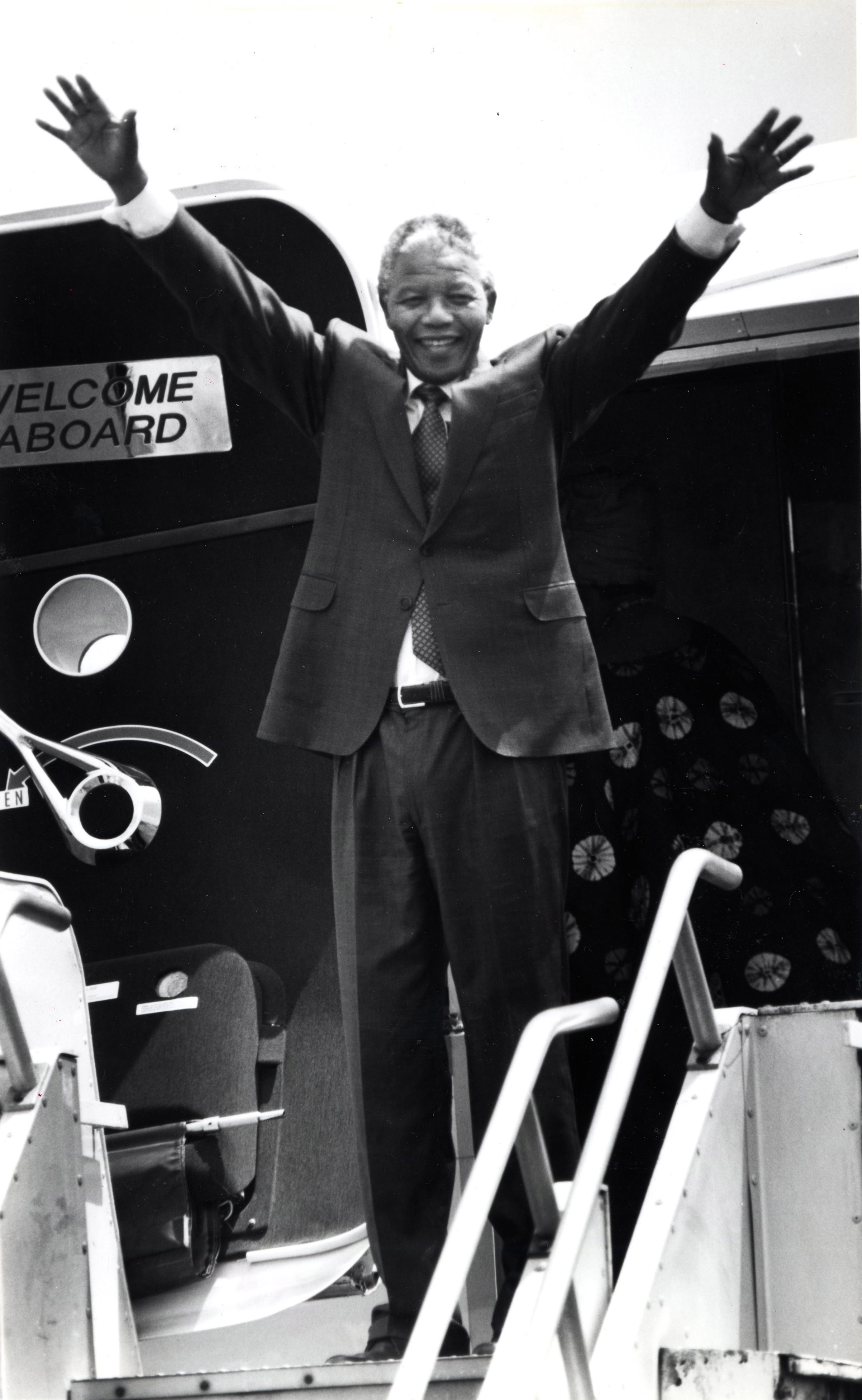 Nelson Mandela waves goodbye to Boston from the airplane doorway on June, 24, 1990.