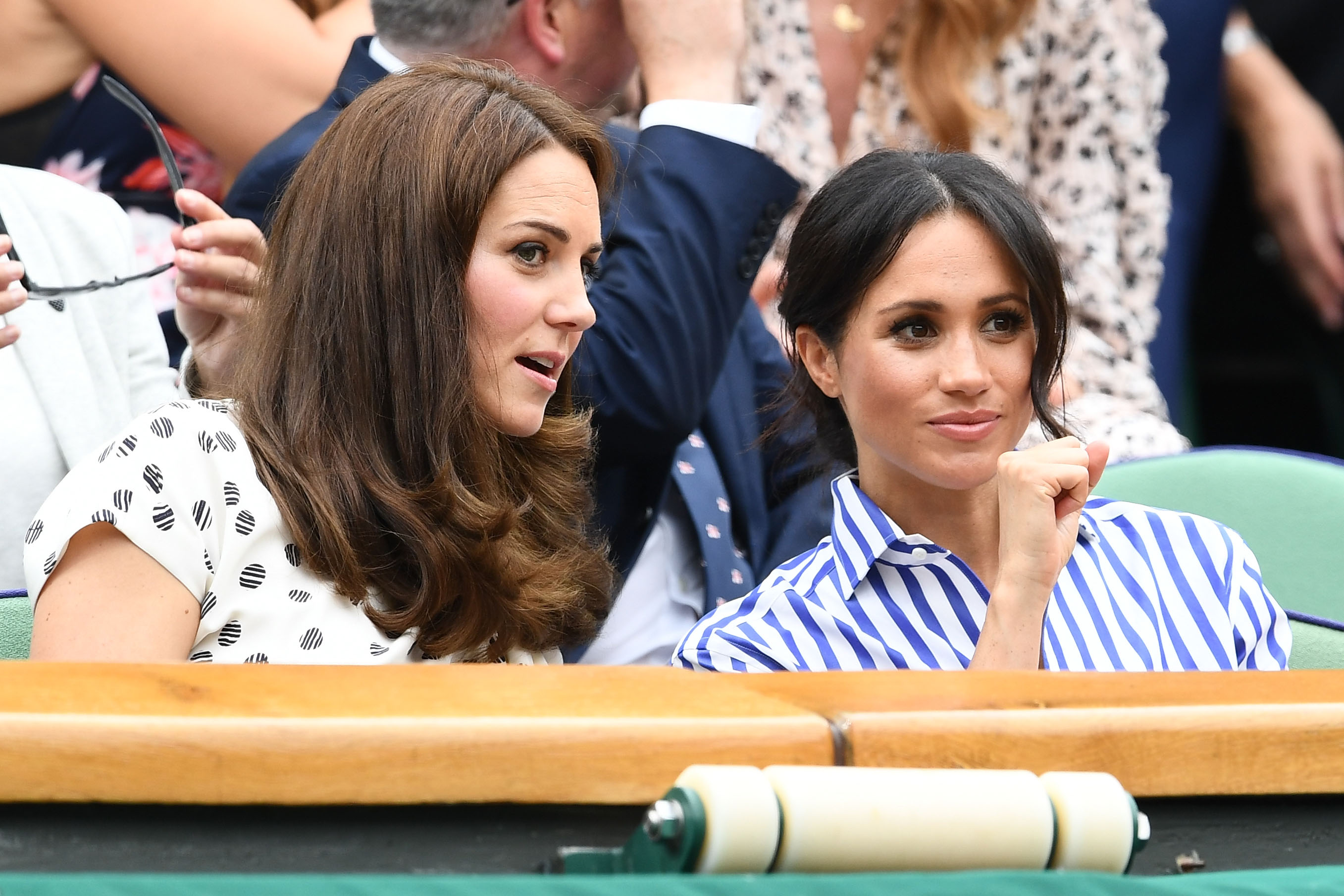 Catherine, Duchess of Cambridge and Meghan, Duchess of Sussex attend day twelve of the Wimbledon Lawn Tennis Championships at All England Lawn Tennis and Croquet Club on July 14 in London, England.