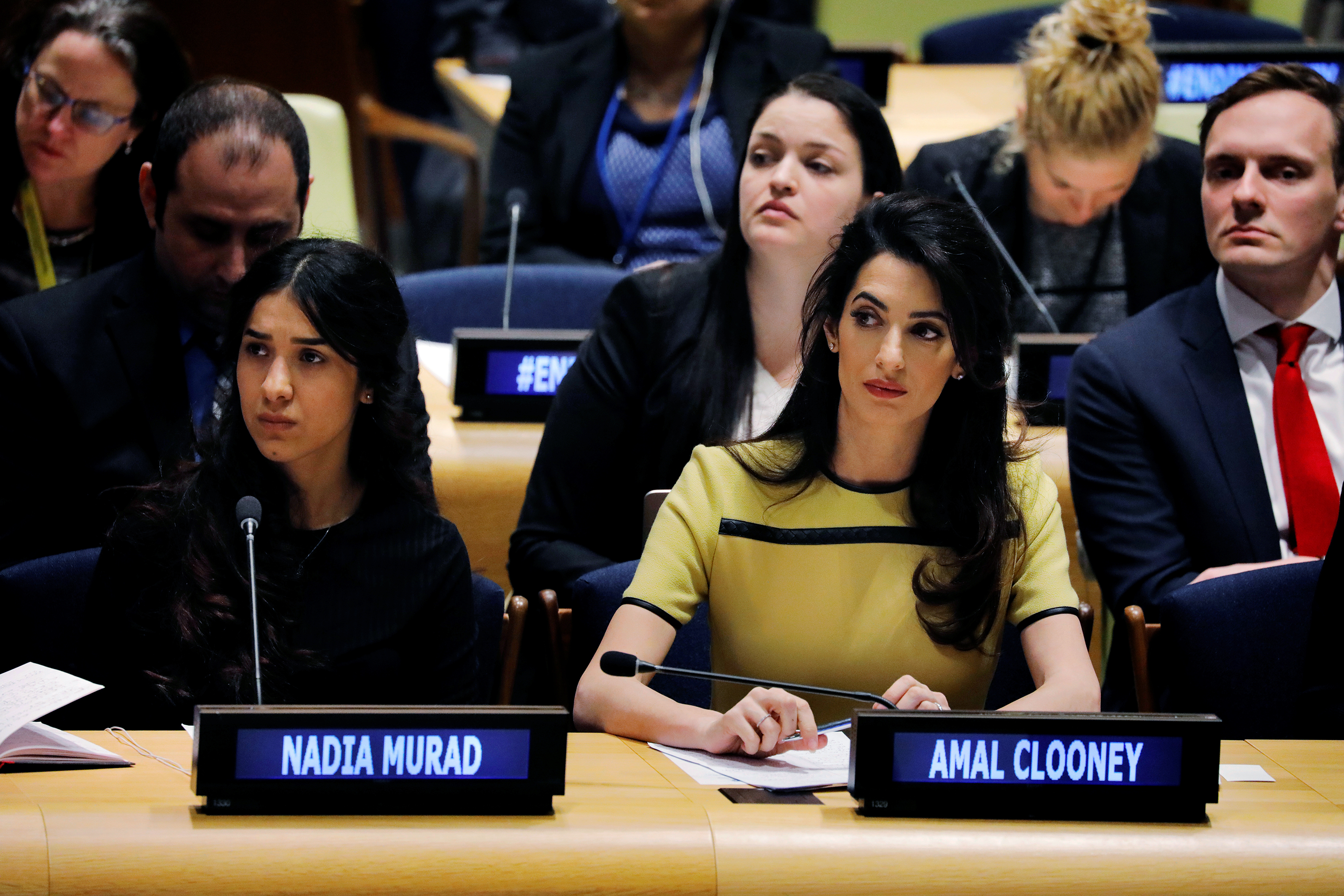 International human rights lawyer Amal Clooney sits with Murad as she waits to address a  Bringing Da'esh to Justice  event at the United Nations headquarters in New York on March 9, 2017.