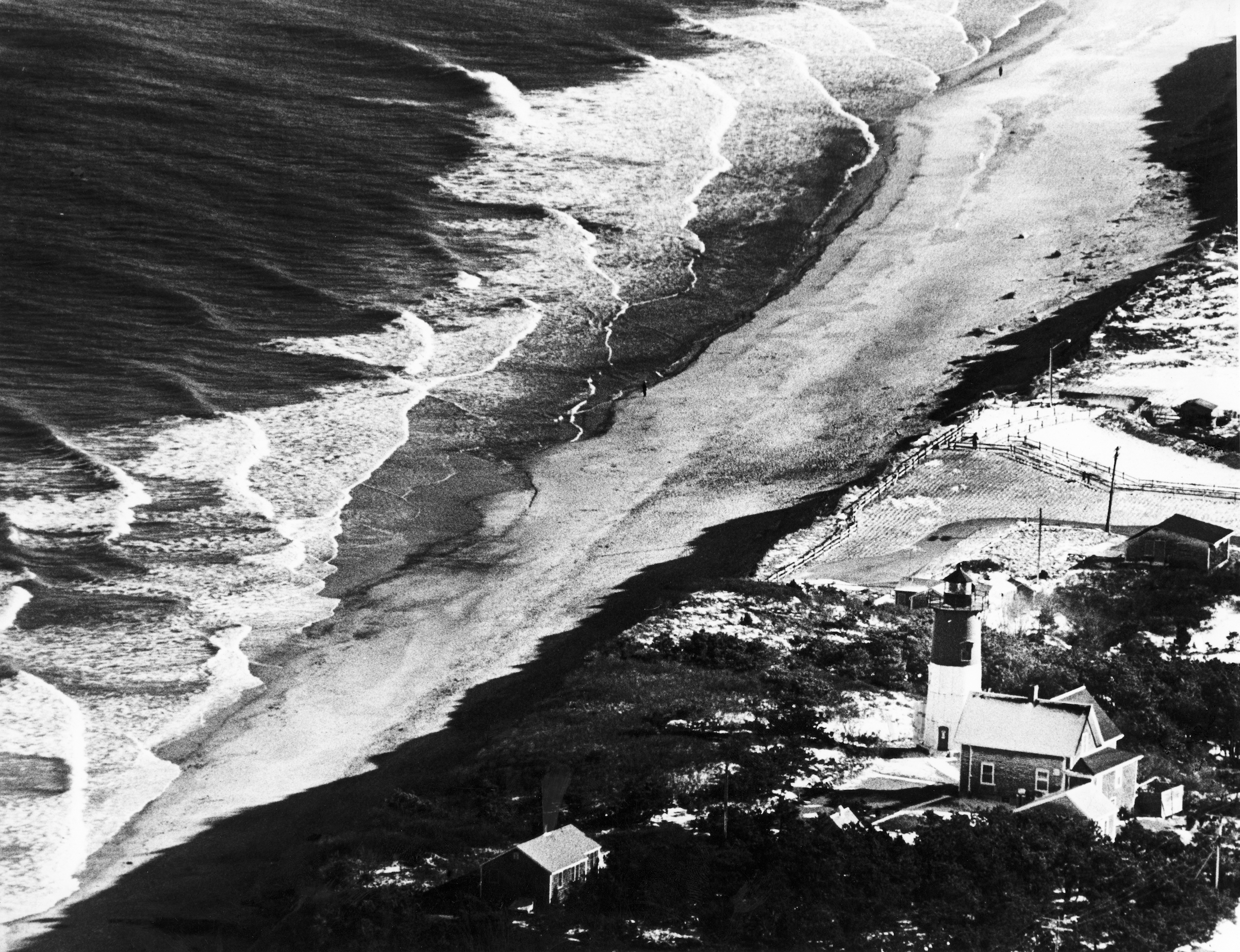Aerial view of waves along the shoreline of Nauset Light Beach in 1987