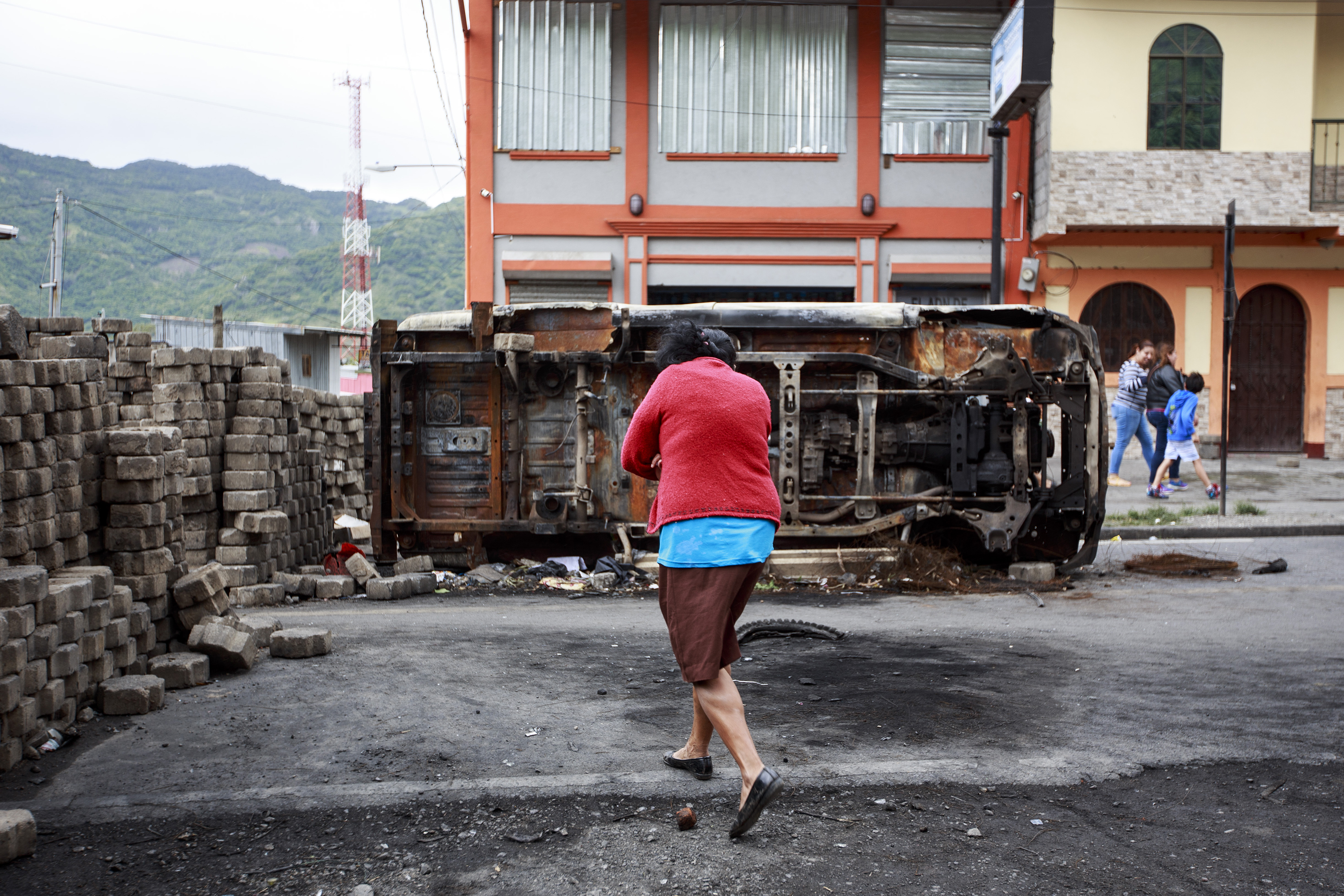 A woman walks near a barricade in Jinotega, north of Managua, Nicaragua, on June 4, 2018.