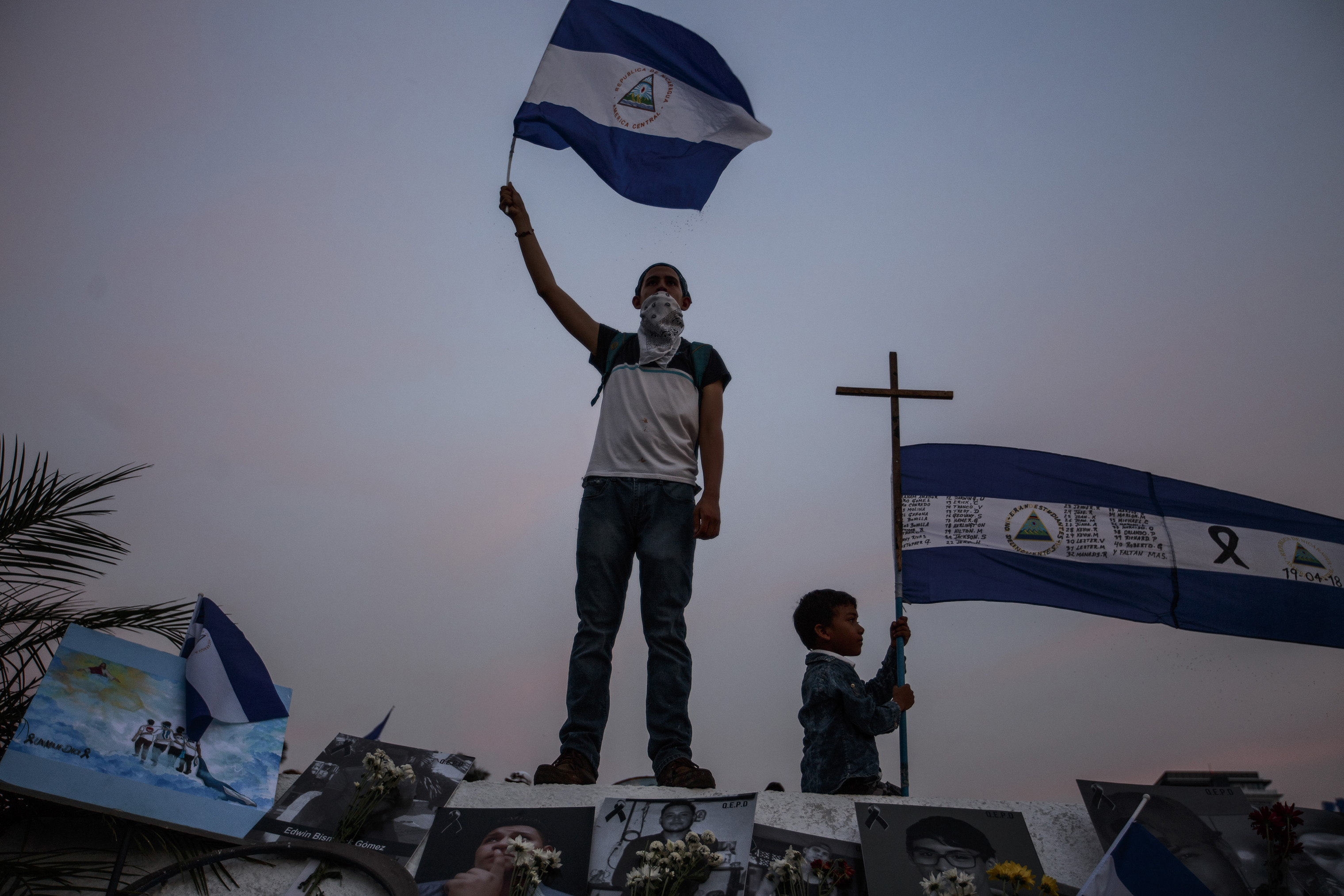 A demonstrator waves a flag during a protest in Managua on April 29.