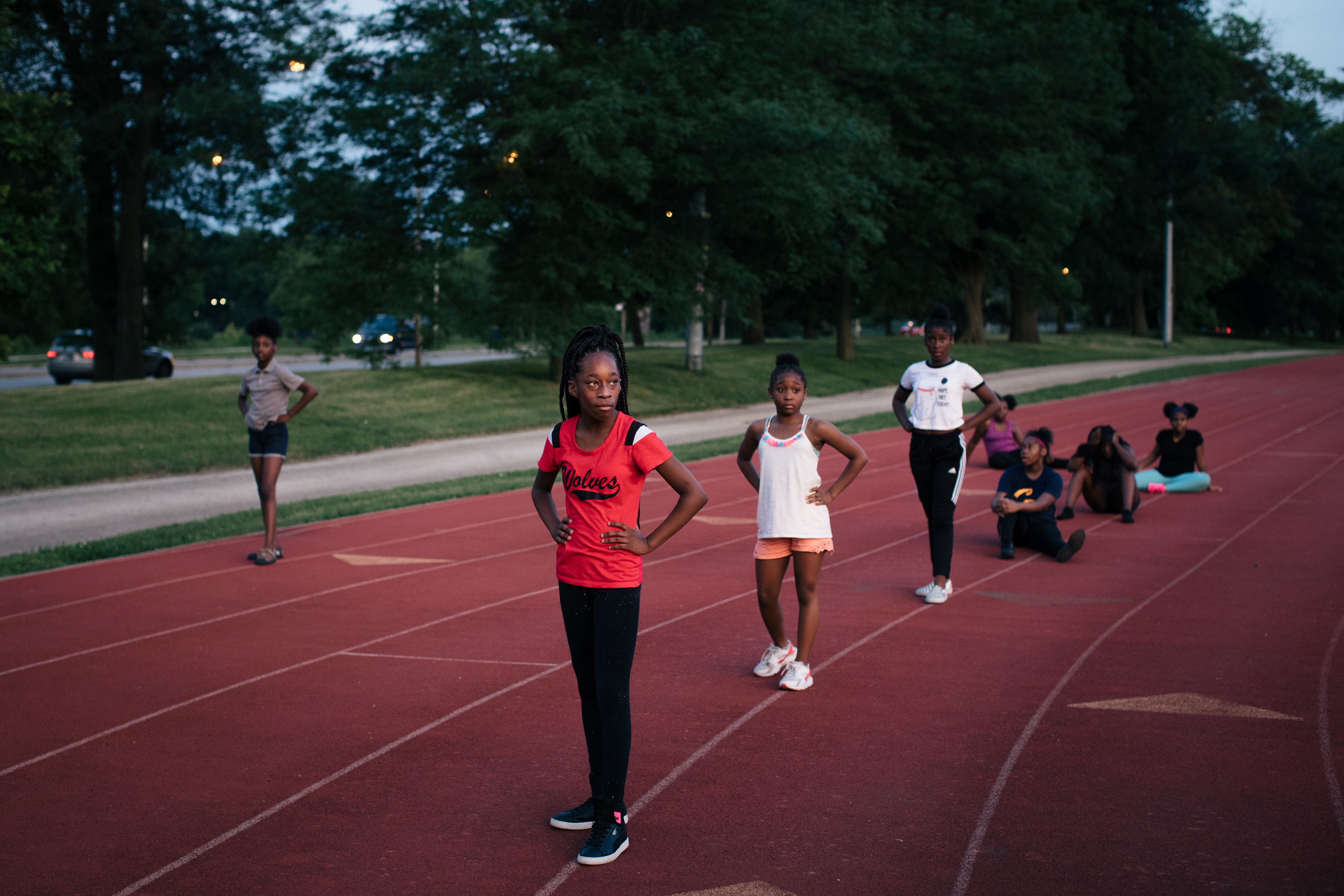 From left, Wolf Pack Football Lady Wolves dancers Deh'Shia Fisher, 12, Vickiya Fisher, 11, and Aniah Nance, 11, practice for the Bud Billiken Parade, an important summer event for Chicago's South Side, at the Jackson Park Football Field, where the Obama Presidential Center is planned to be built.