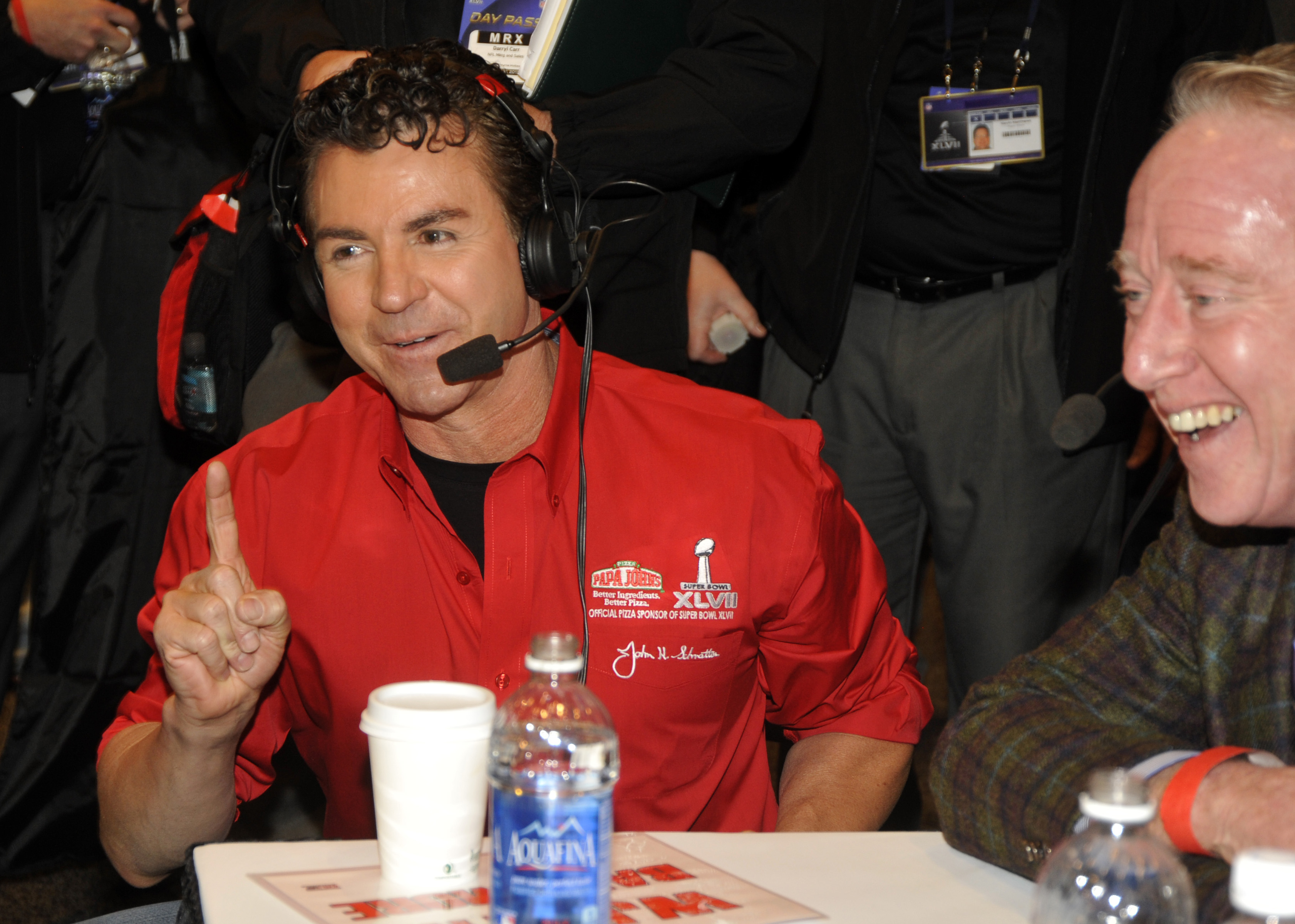 Papa John's Founder, Chairman and CEO John Schnatter, left, and NFL legend Archie Manning, right, share a laugh at the NFL Media Center, promoting Papa John's Super Bowl XLVII Coin Toss Experience, in New Orleans.